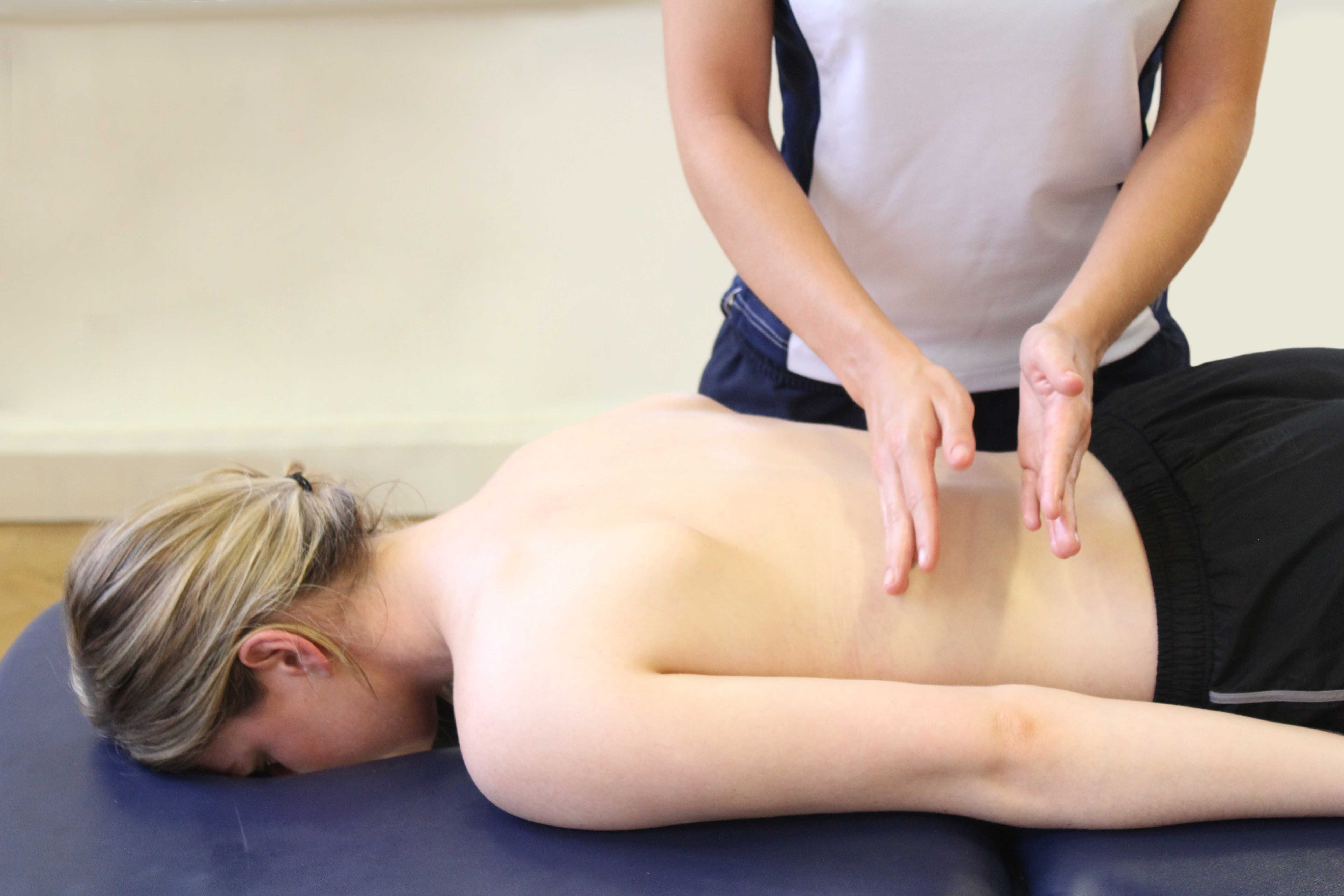 Hacking purcussion soft tissue massage conducted by an experienced therapist