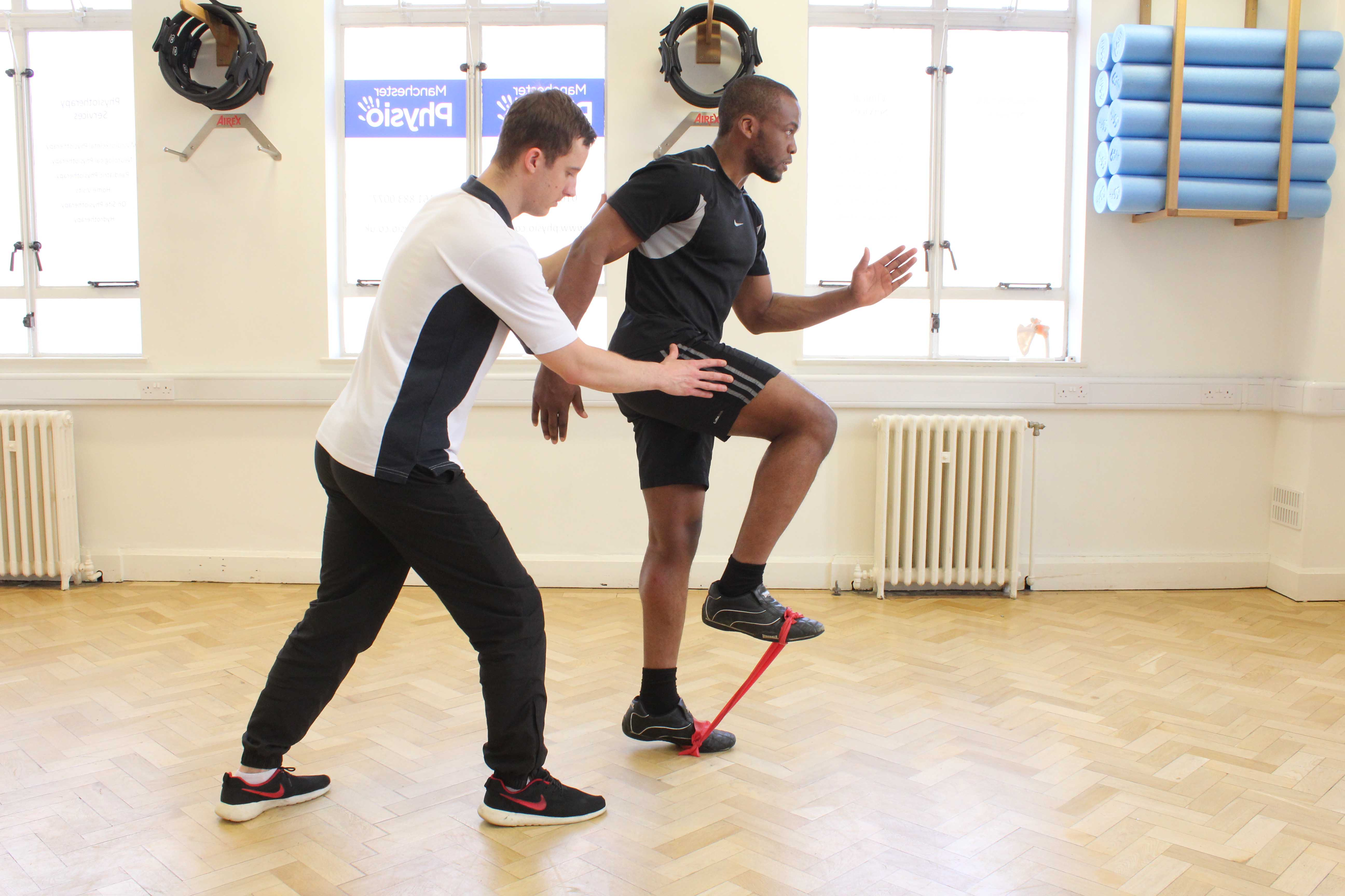 Sport rehabilitation mobility exercises using a resistance band under physiotherapy supervision
