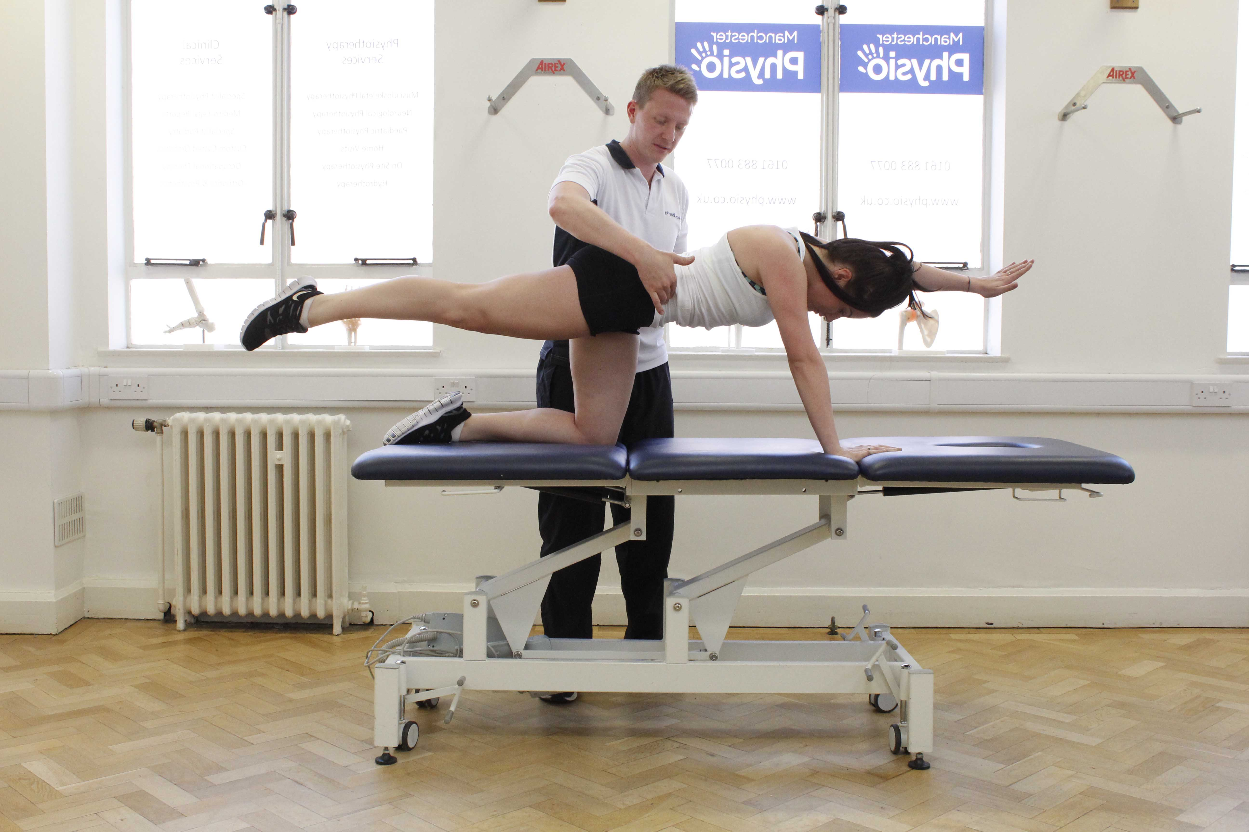Lower back toning exercises performed on plinth