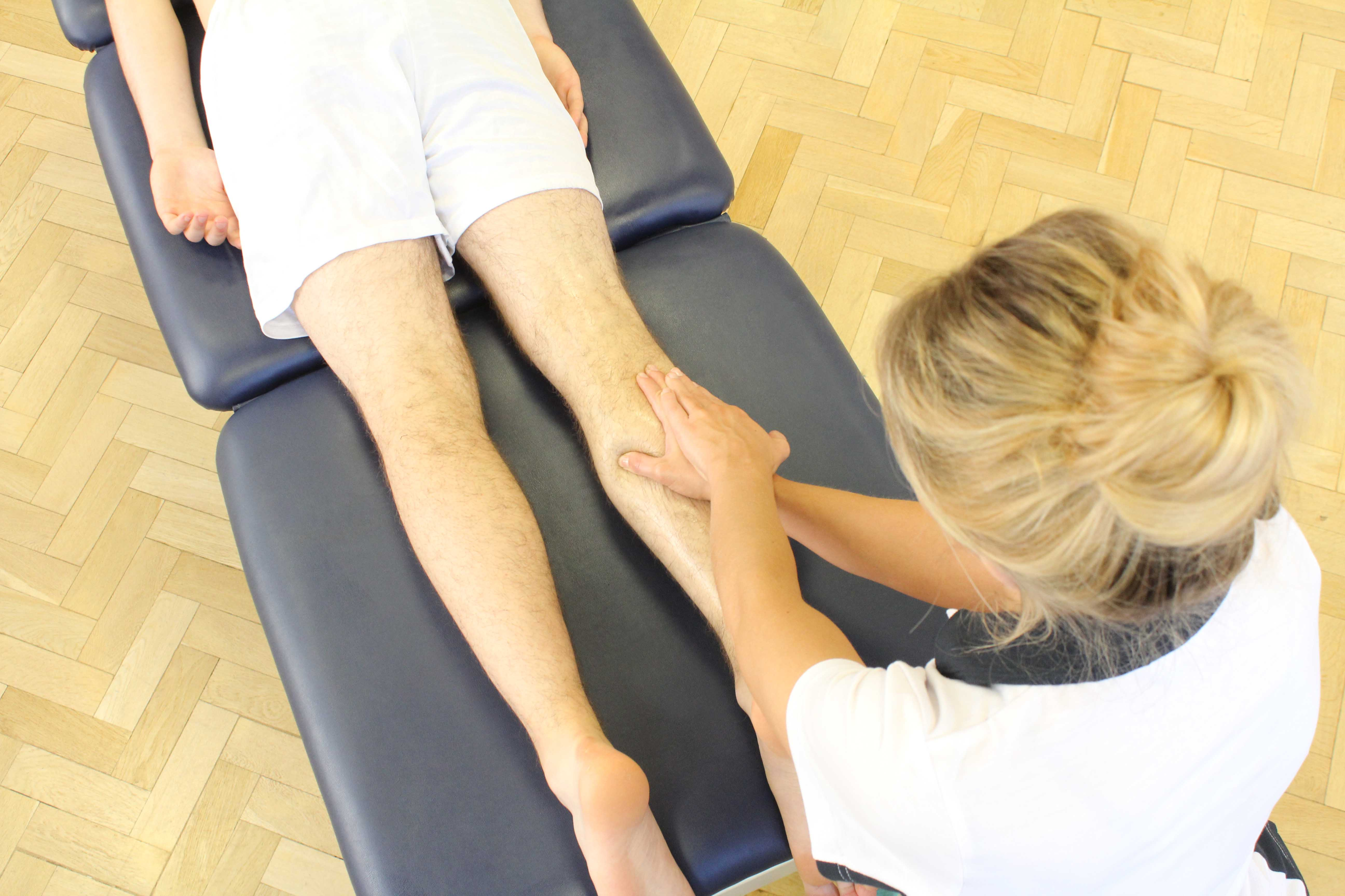 Soft tissue massage of the gastrocnemius muscle by MSK therapist