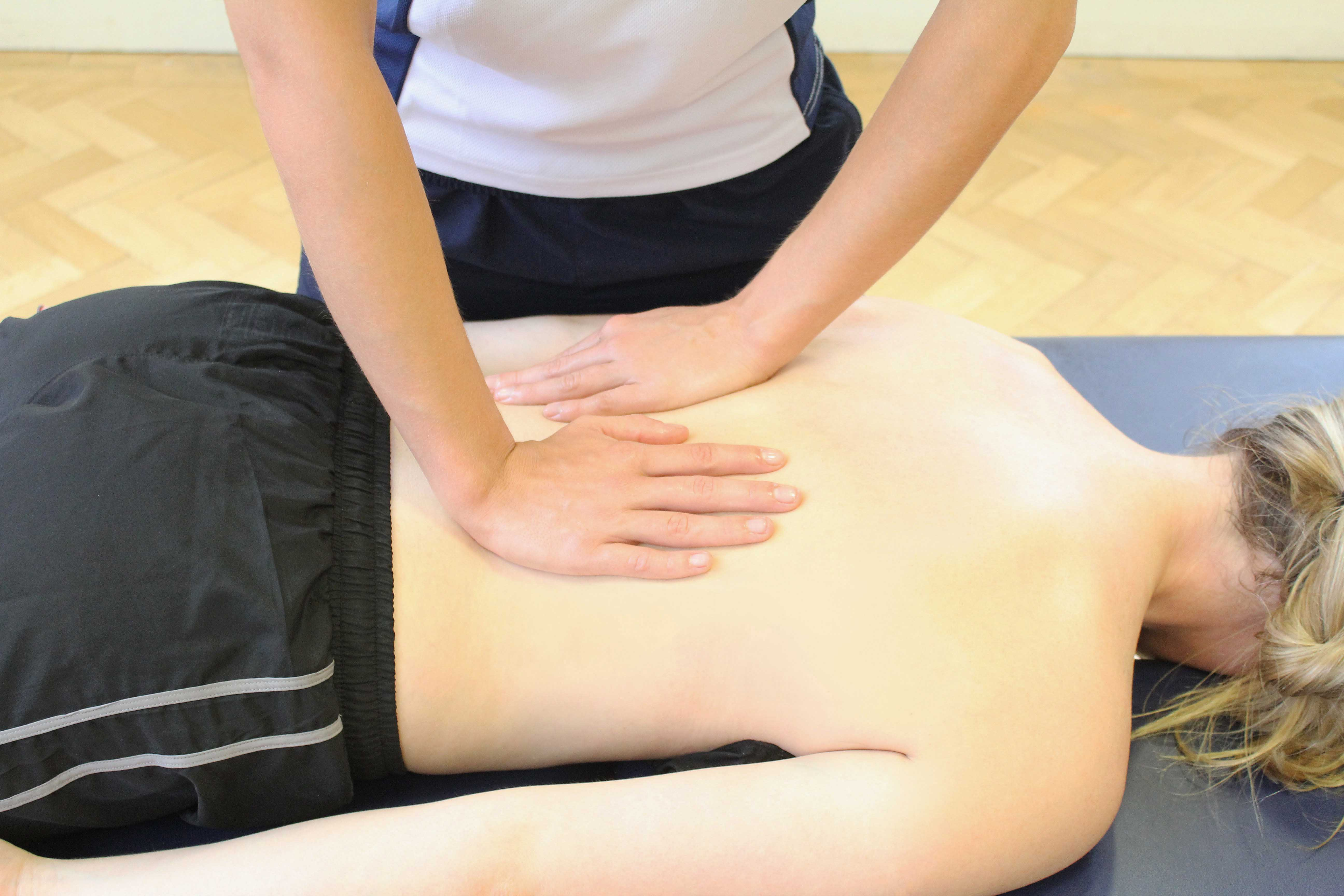 Soft tissue massage of the lower back muscles and connective tissue by specialist therapist
