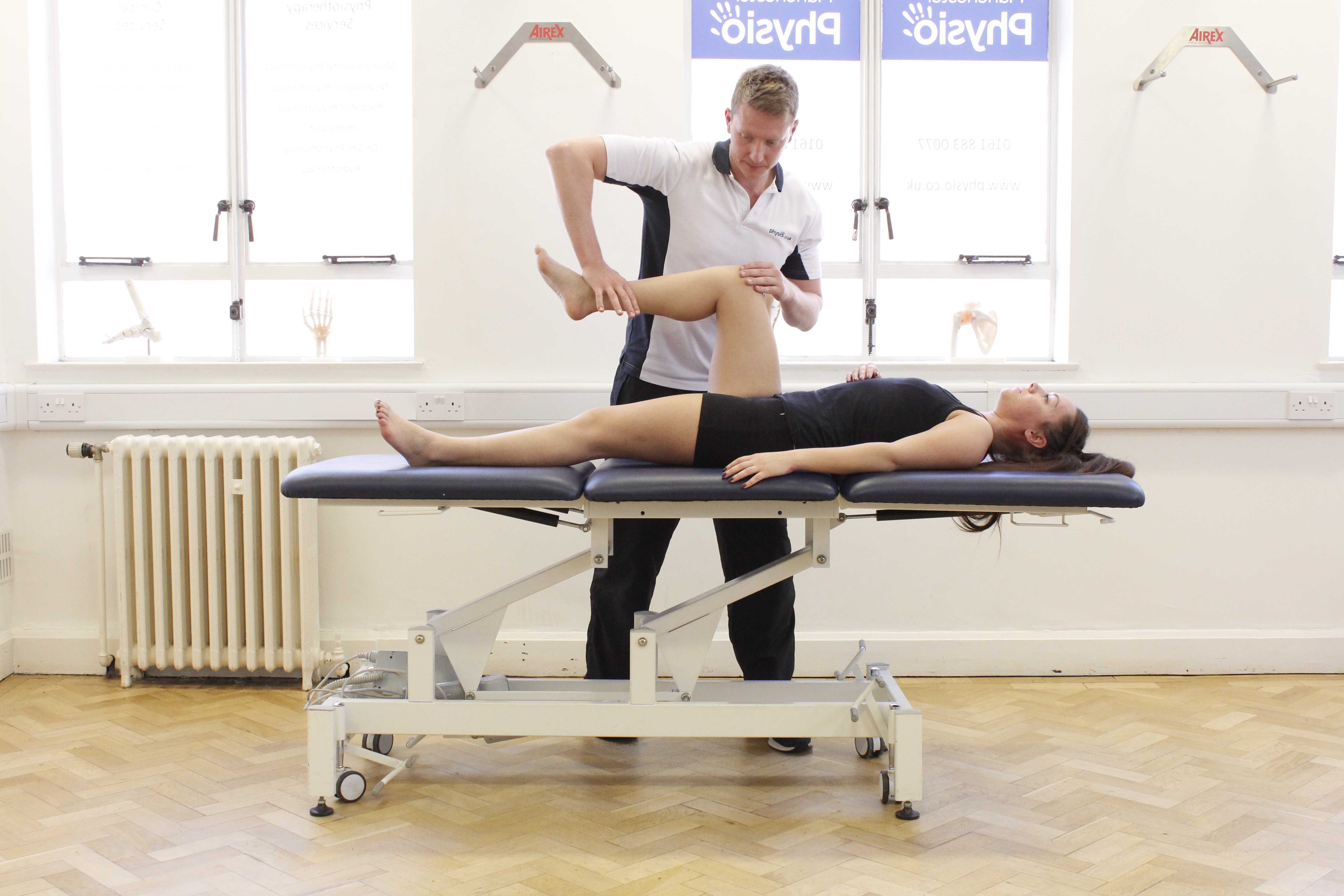 Strength testing during a physical assessment conducted by an experienced physiotherapist