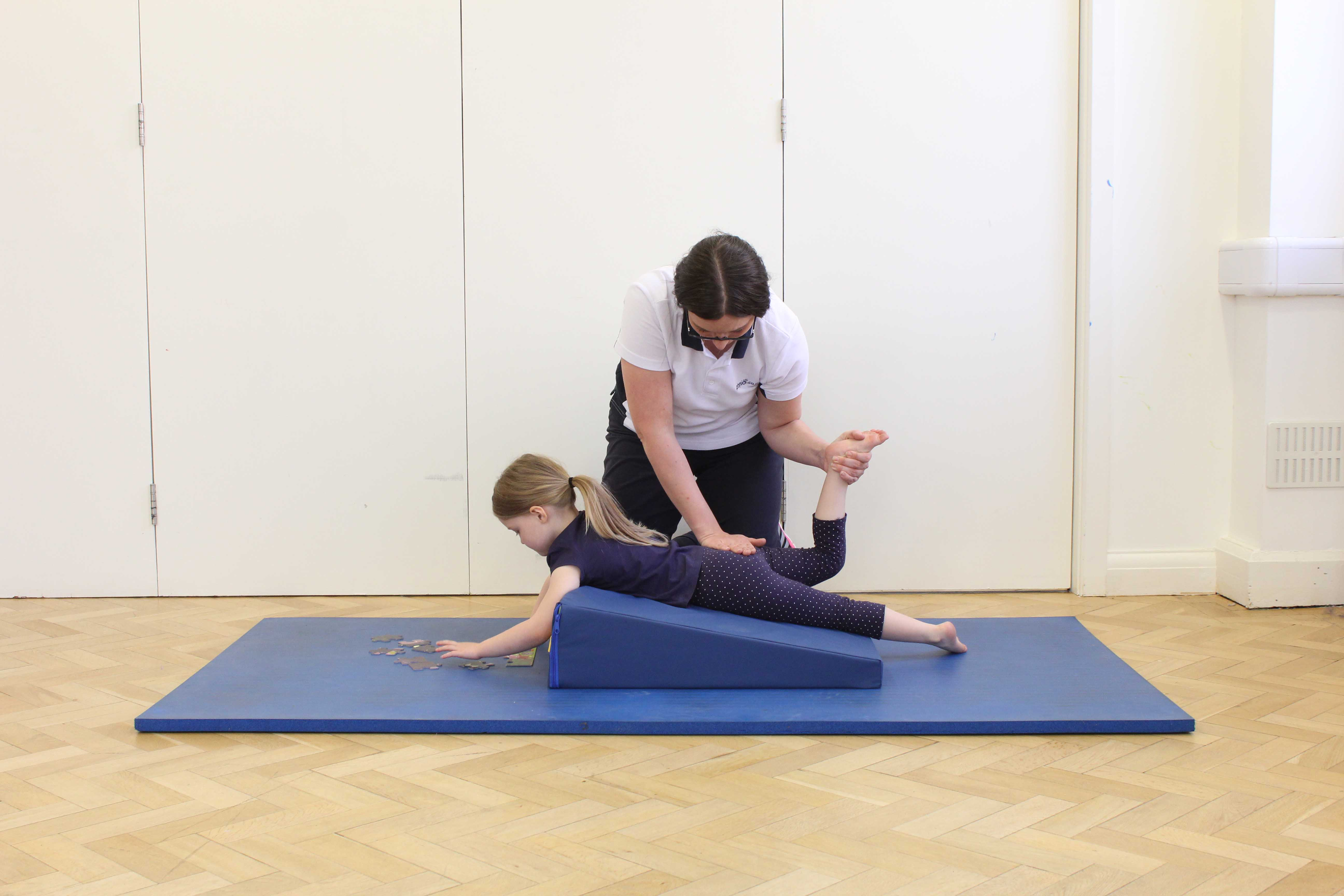 Massage and stretches of the hip and knee applied by a specialist paediatric physiotherapist