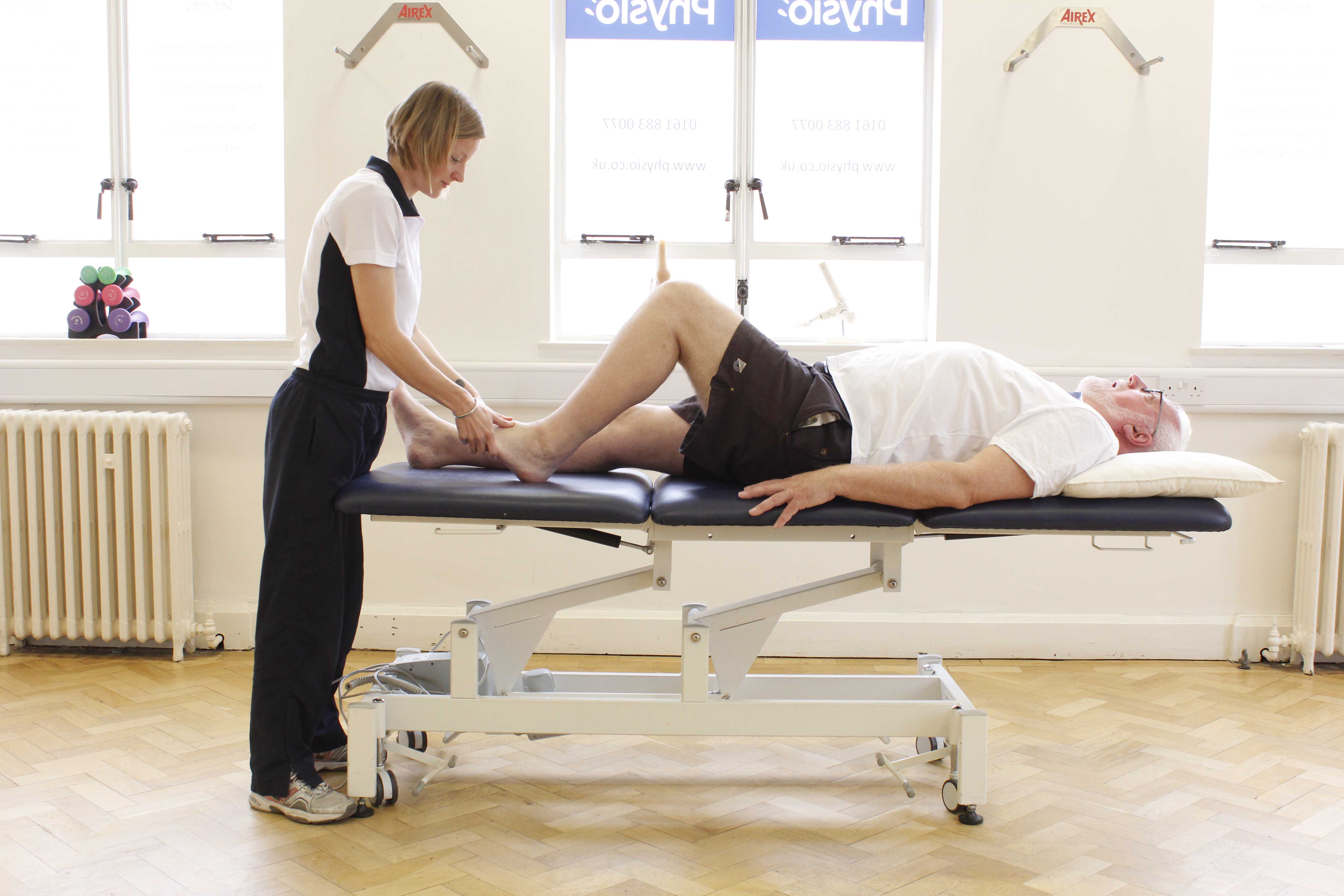 Massage and mobilisation of the ankle by a physiotherapist