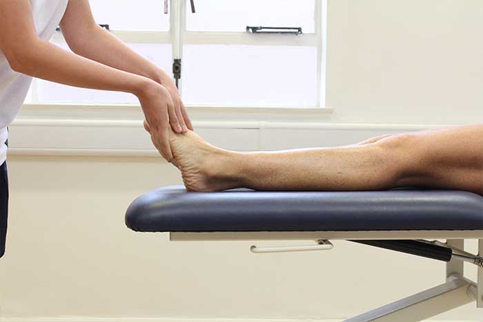 Customer receiving foot massage in relaxed position in Manchester Physio Clinic