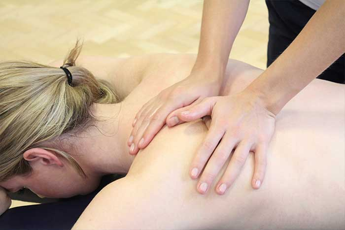 Customer given a shoulder massage while in a relaxed position in Manchester Physio Clinic