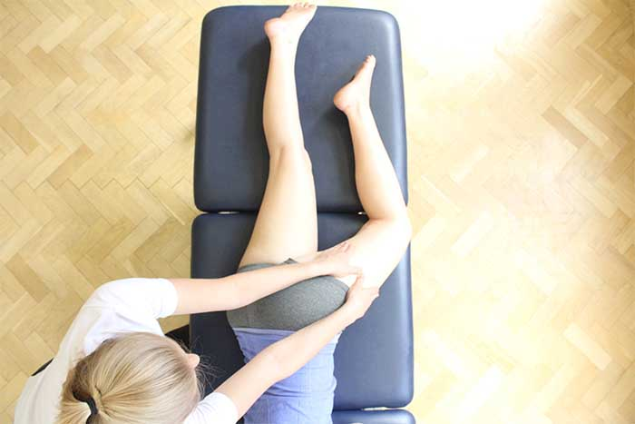 Customer reciving buttock massage while in relaxed position in Manchester Physio Clinic