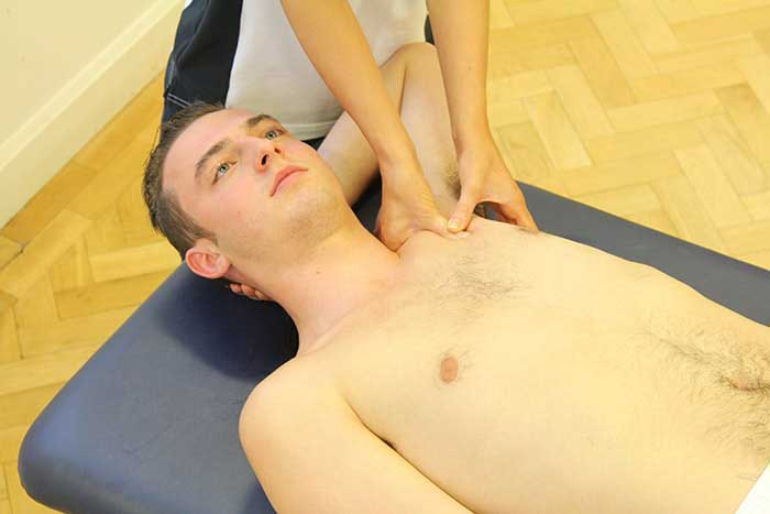 Customer receiving upper shoulder massage in Manchester Physio Clinic