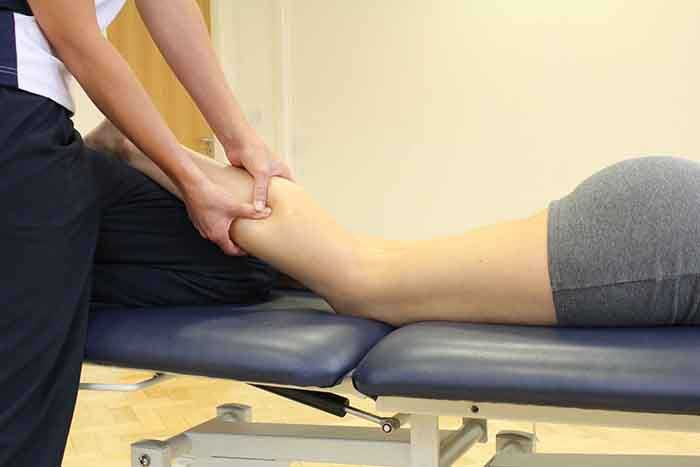 Customer recieveing a calf massage in Manchester Physio Clinic