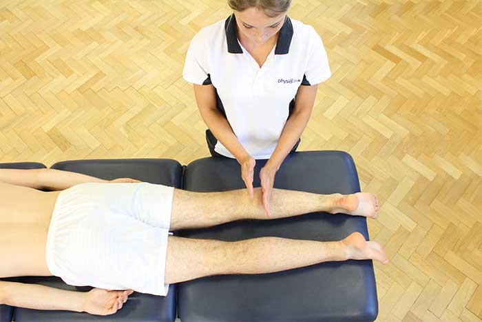 Customer receiving lower leg massage in Manchester Physio Clinic