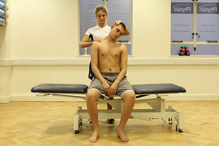 Customer receiving a neck stretch while in a sitting up position in Manchester Physio Clinic
