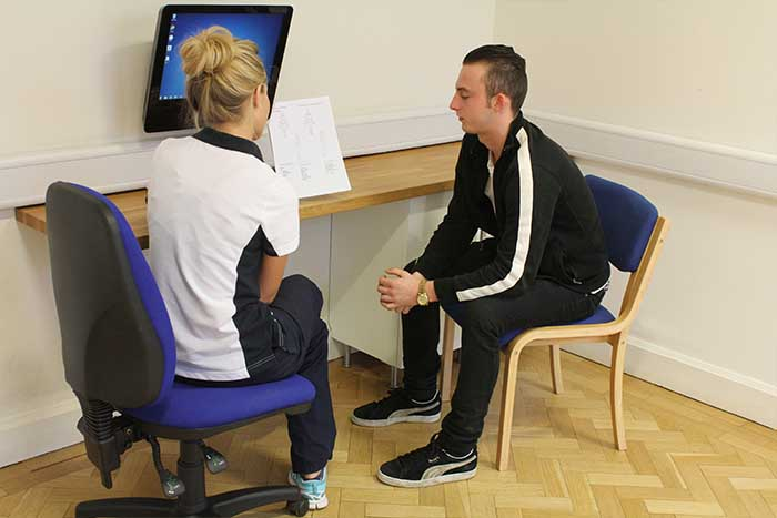 Customer receiving after session guidance from instructor in Manchester Physio Clinic