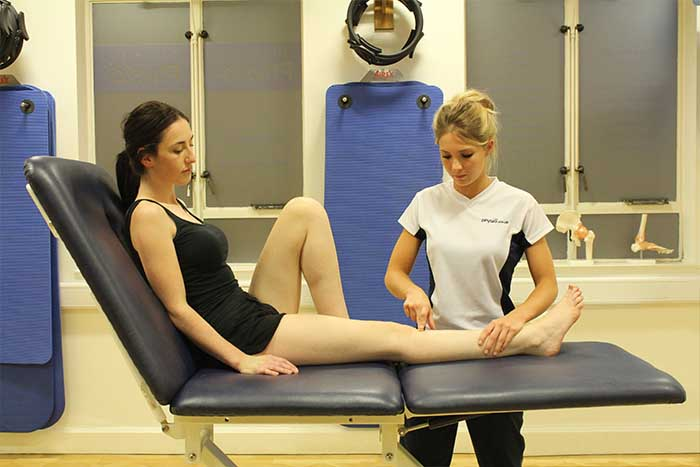 Customer receiving a leg massage while in a relaxed position