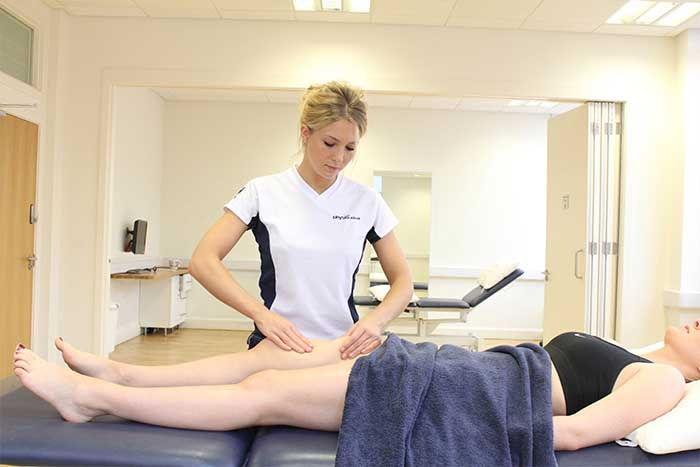 Customer receiving thigh massage while in relaxed position in Manchester Physio Clinic