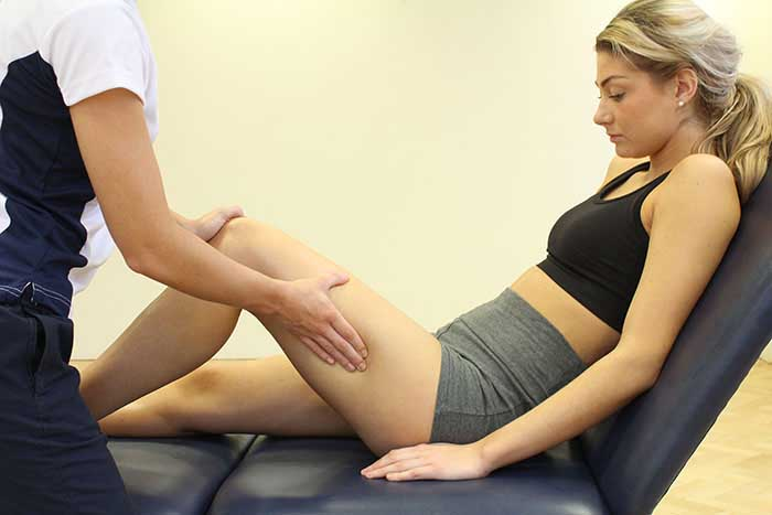 Customer Receiving upper leg massage in Manchester Physio Clinic