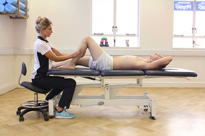 Customer reciving lower leg massage in Manchester Physio Clinic