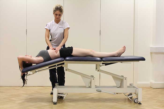 Customer receiving abdominal stretches while given massage in Manchester Physio Clinic