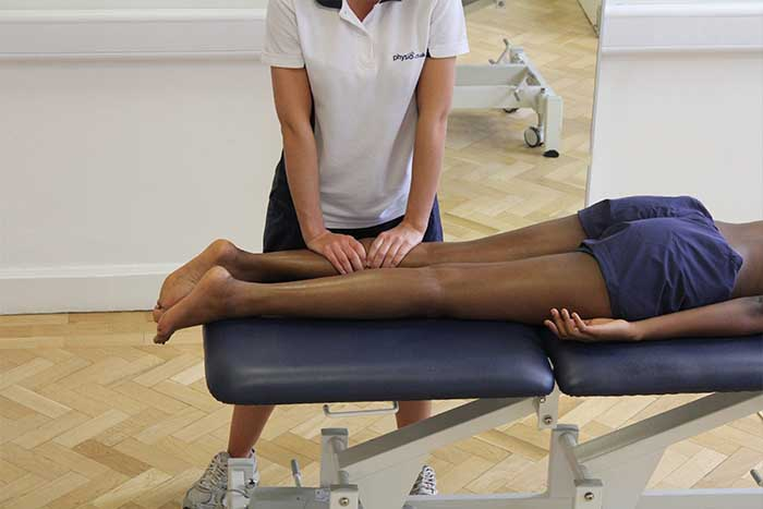 Customer receiving lower leg massage while in relaxed position in Manchester Physio Clinic