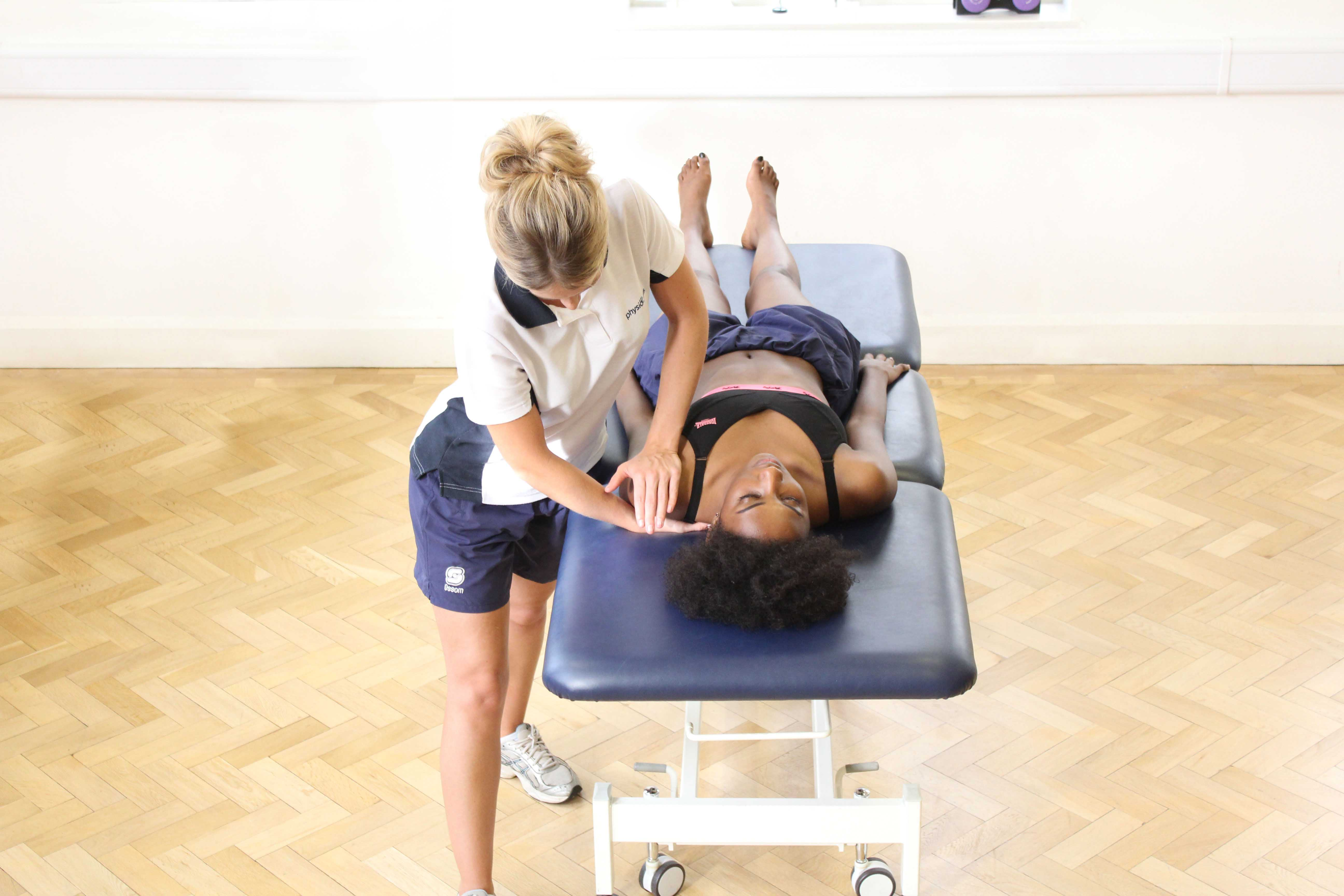 Mobilisations of the lumbar vertebrea by a specilaist physiotherapist