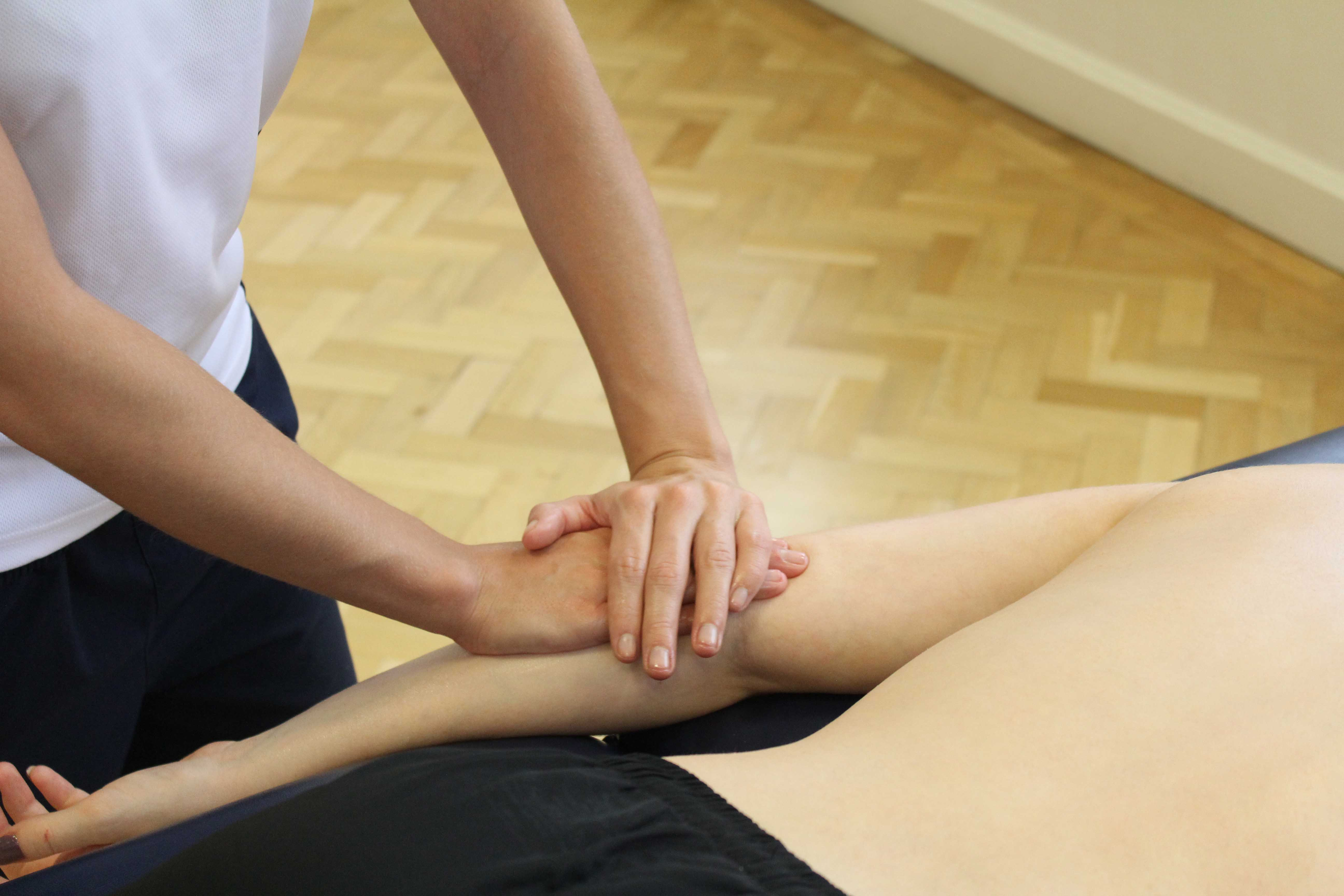 Soft tissue massage and mobilisation of the connective tissues around the elbow joint.