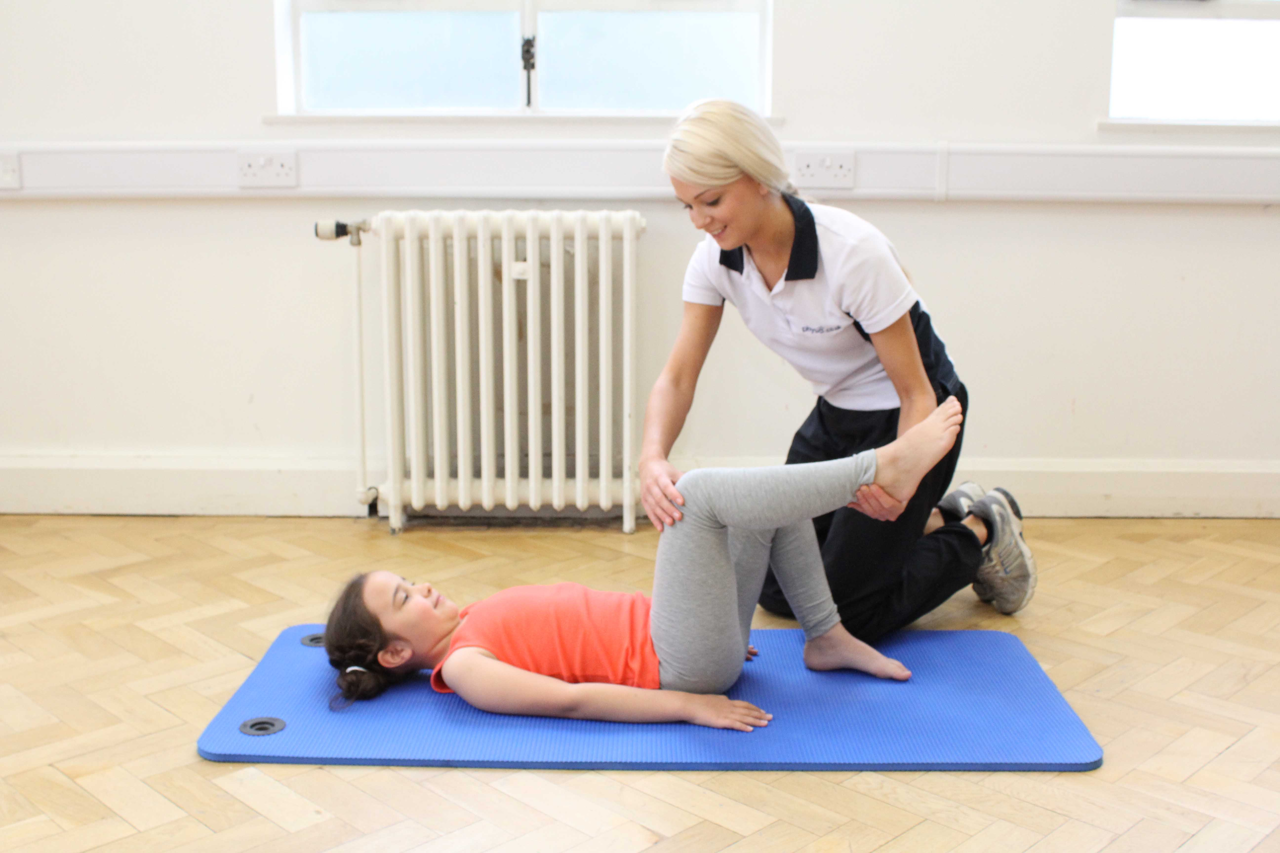 Passive hip, hamstring and calf stretches performed by an experienced paediatric physiotherapist