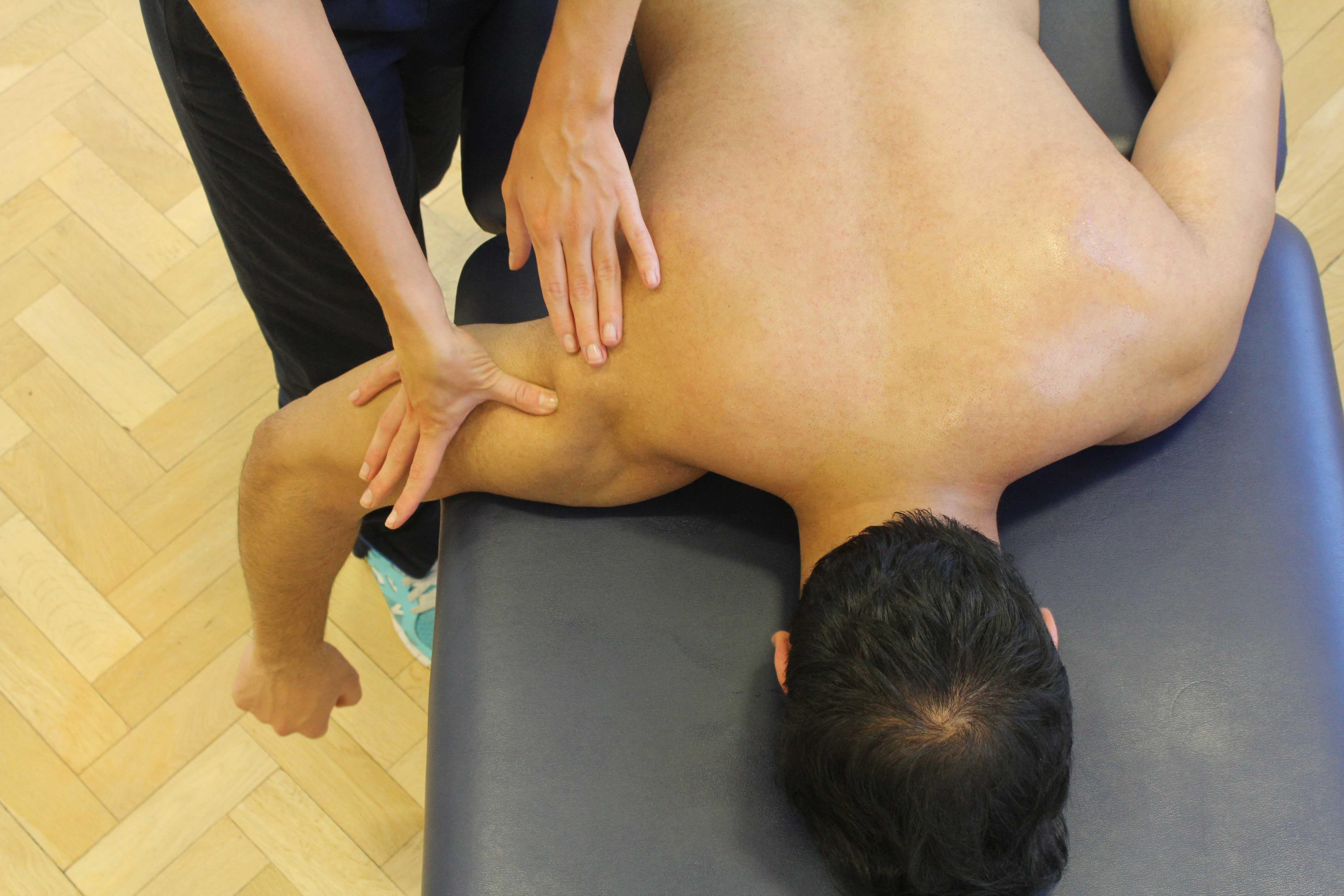 Mobilisation of the shoulder joint by experienced physiotherapist