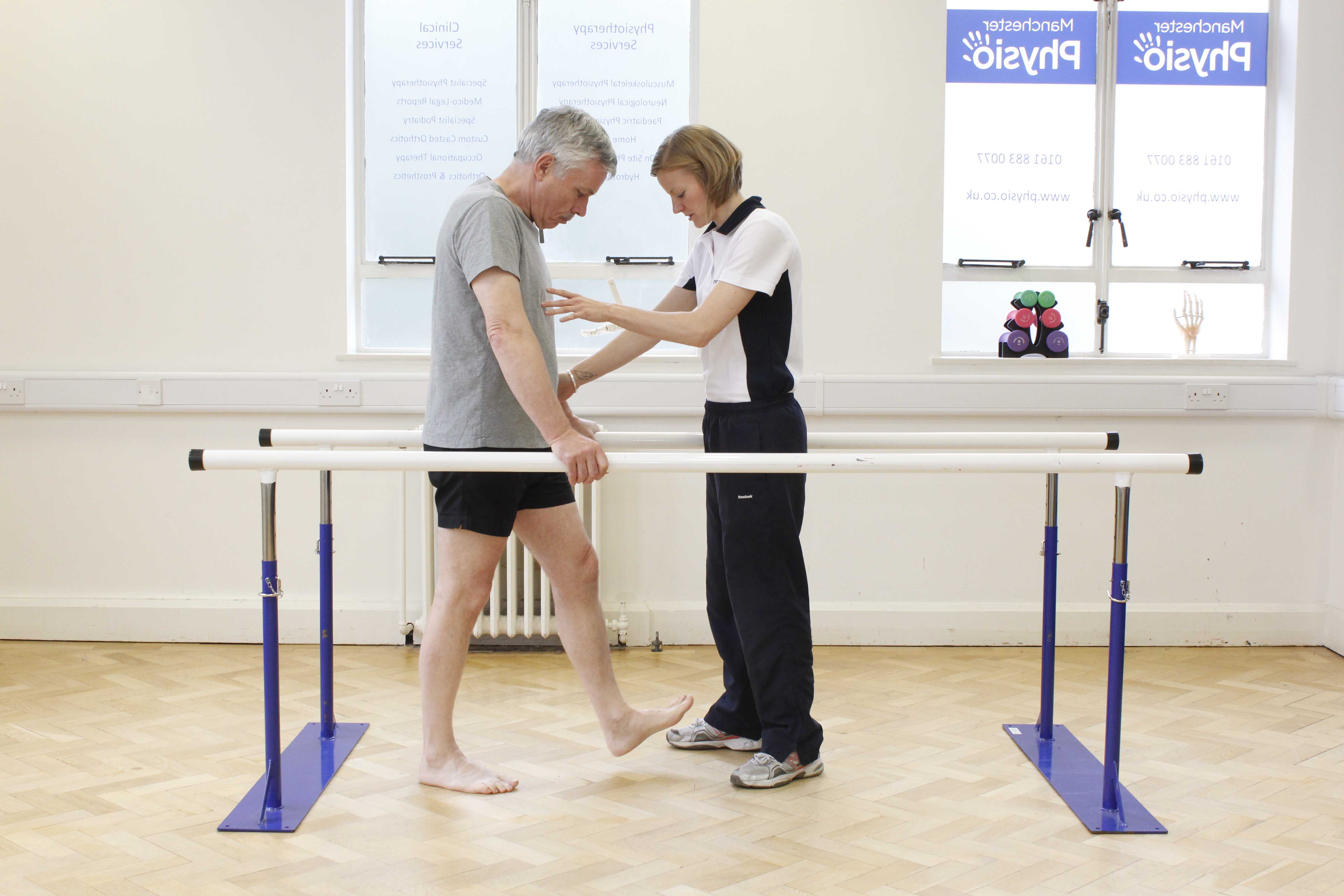 Mobility exercises between the parallel bars assisted by specialist neurological physiotherapist