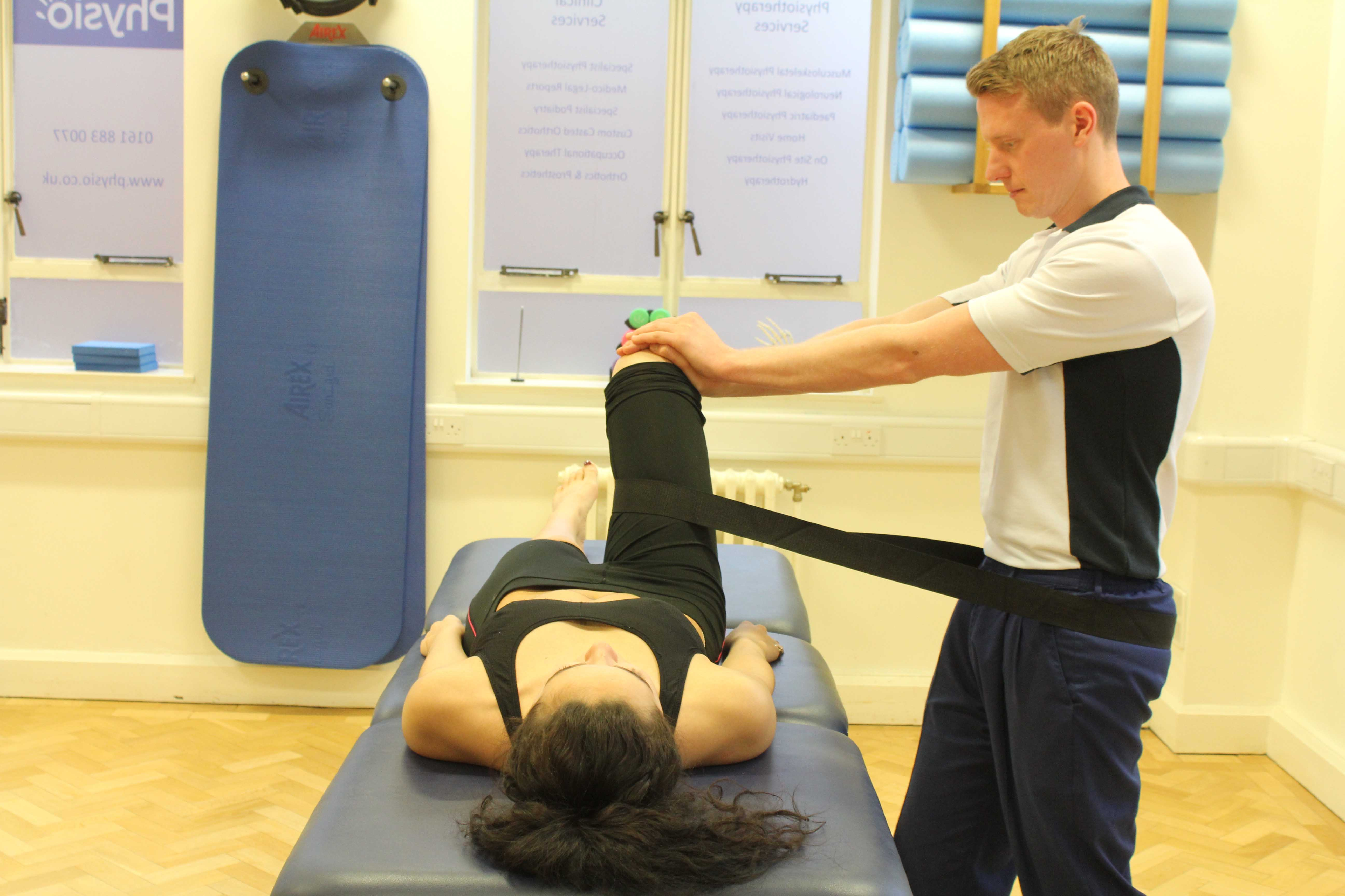 Mobilisations of the hip joint with a strap by an experienced physiotherapist