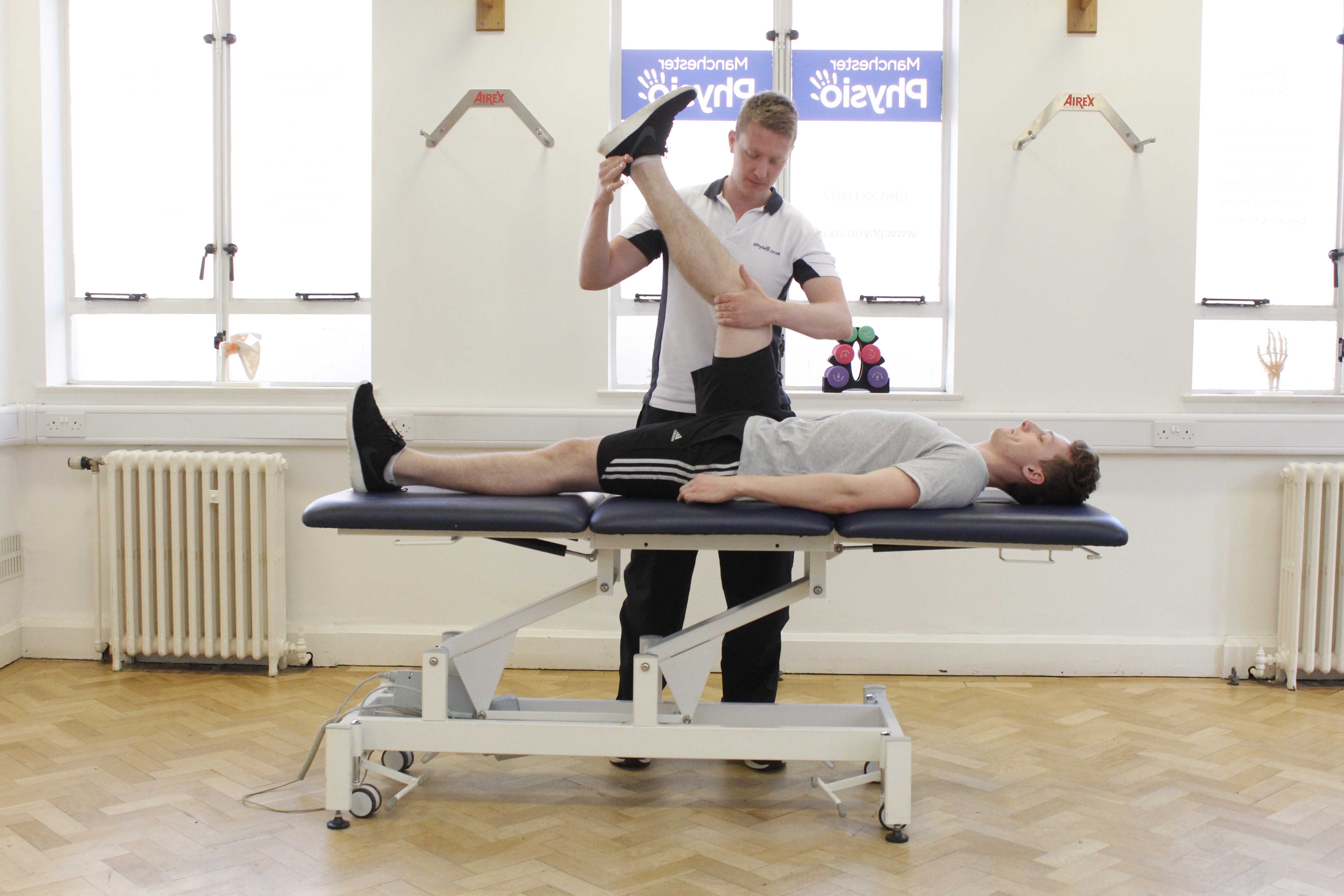 Passive stretch to hamstring and calf muscles, applied by physiotherapist