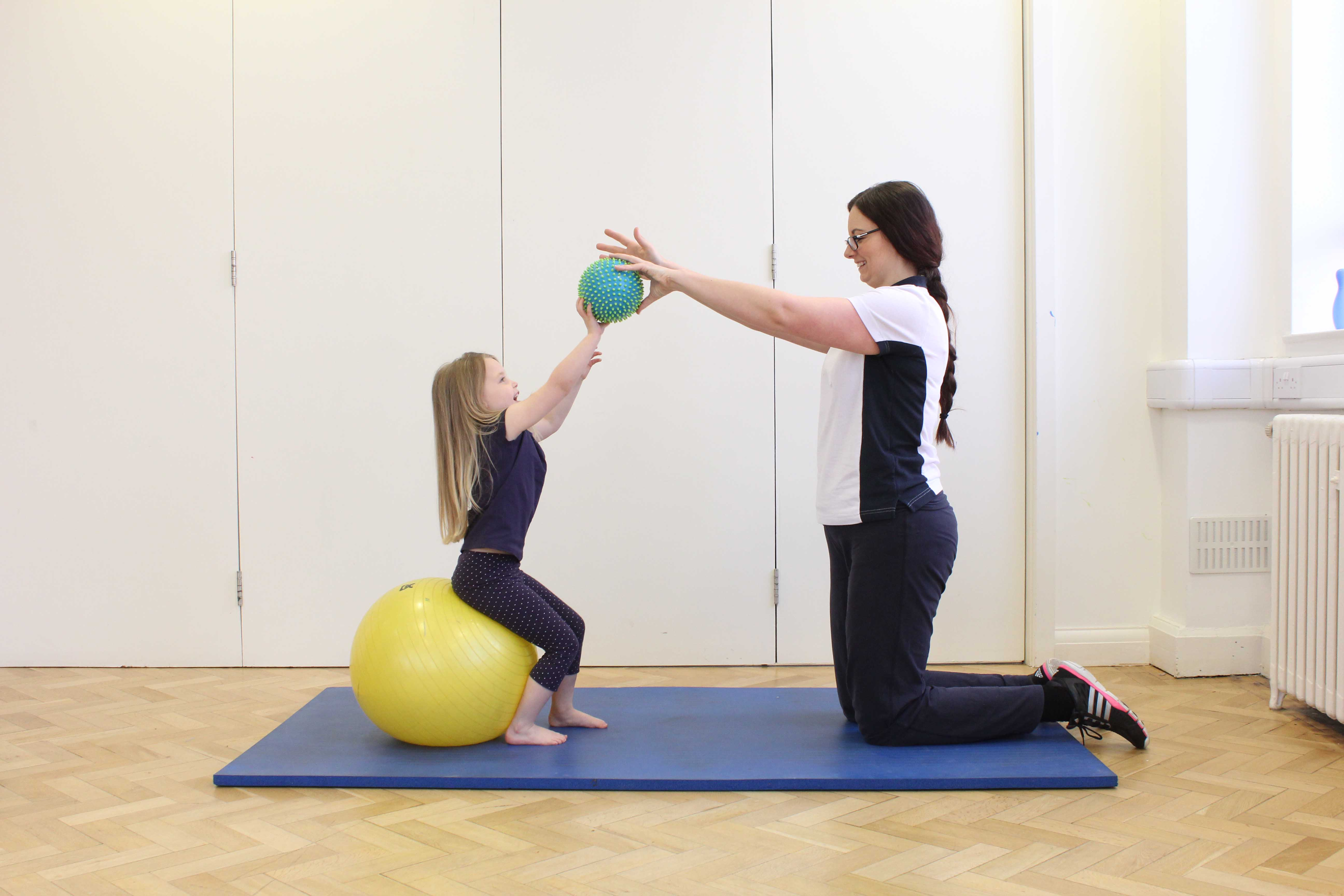 Core stability and strengthening exercises assisted by a paediatric physiotherapist