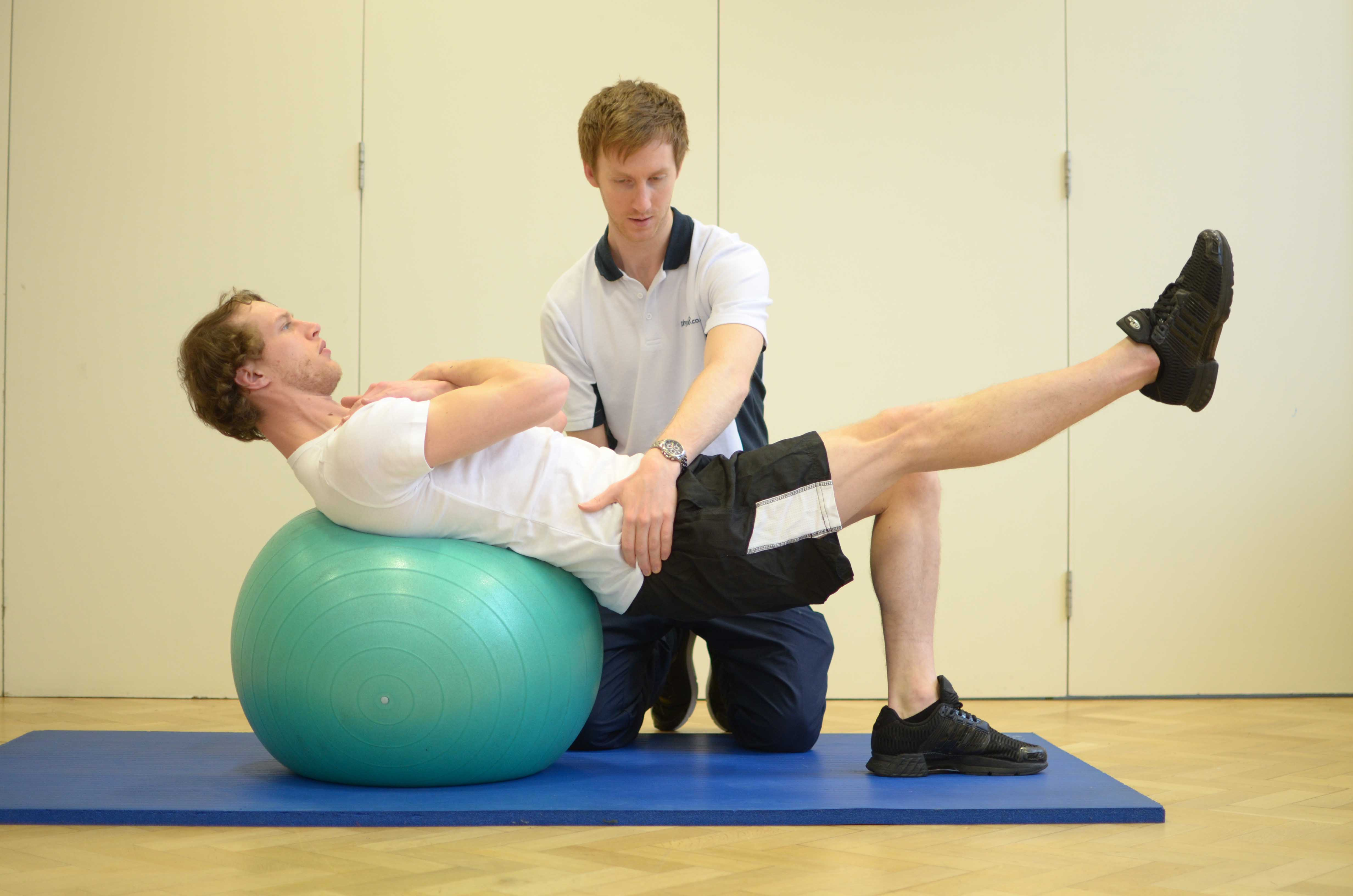 Passive stretch applied by physiotherapist to calf and hamstring muscles