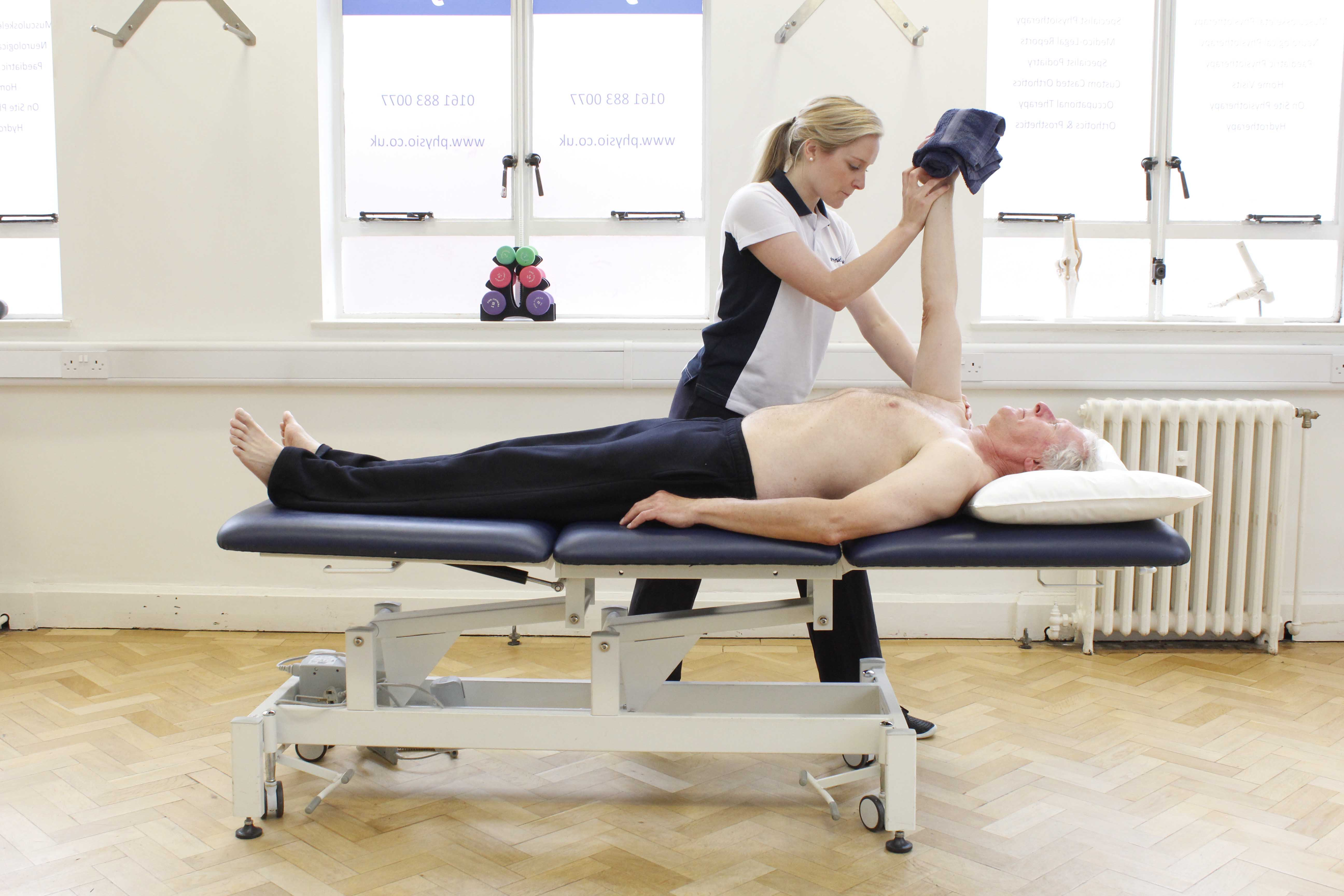 Upper limb mobilisation and stretches performed by a specialist neurological physiotherapist
