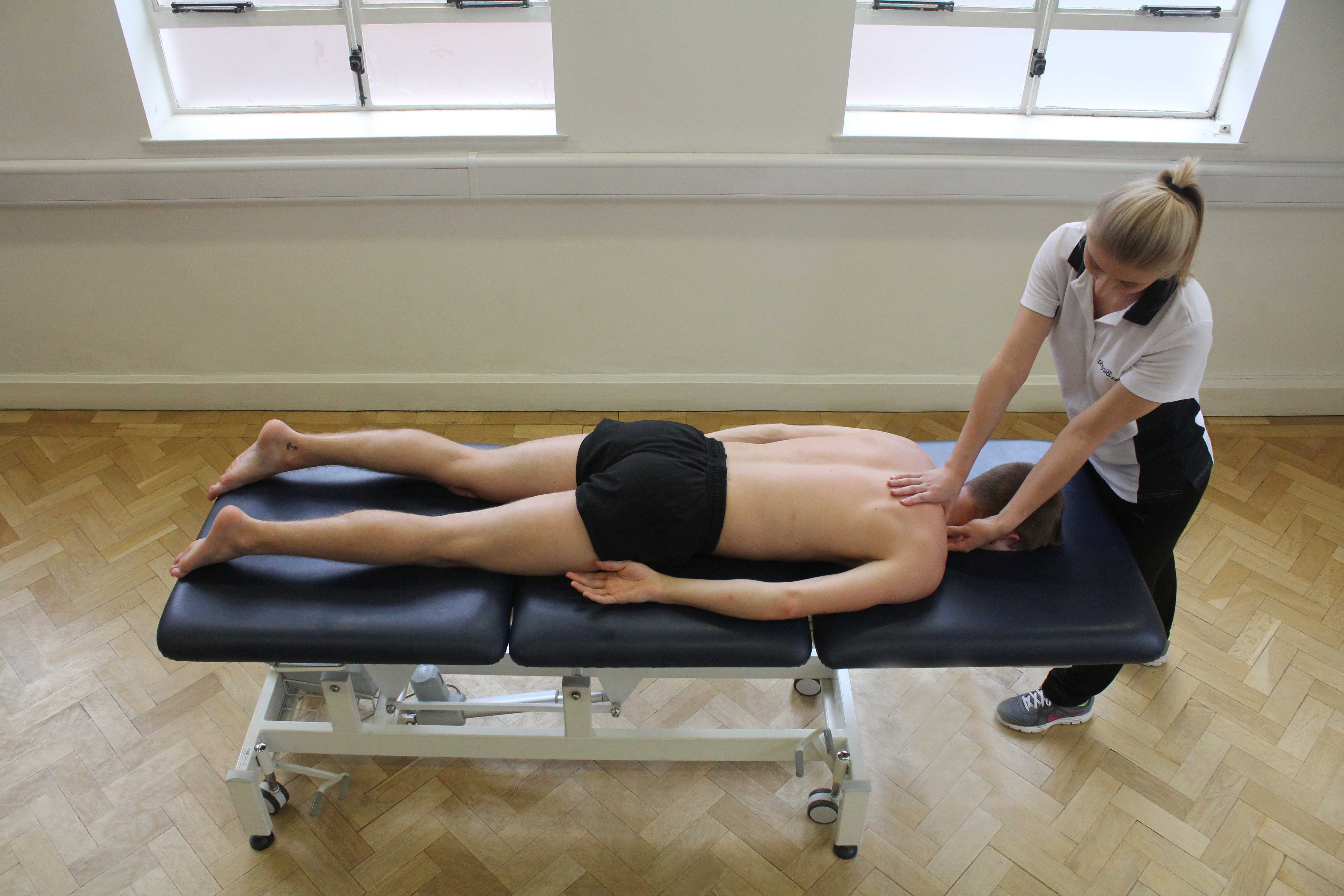 Trigger point massage applied to trapezius muscle