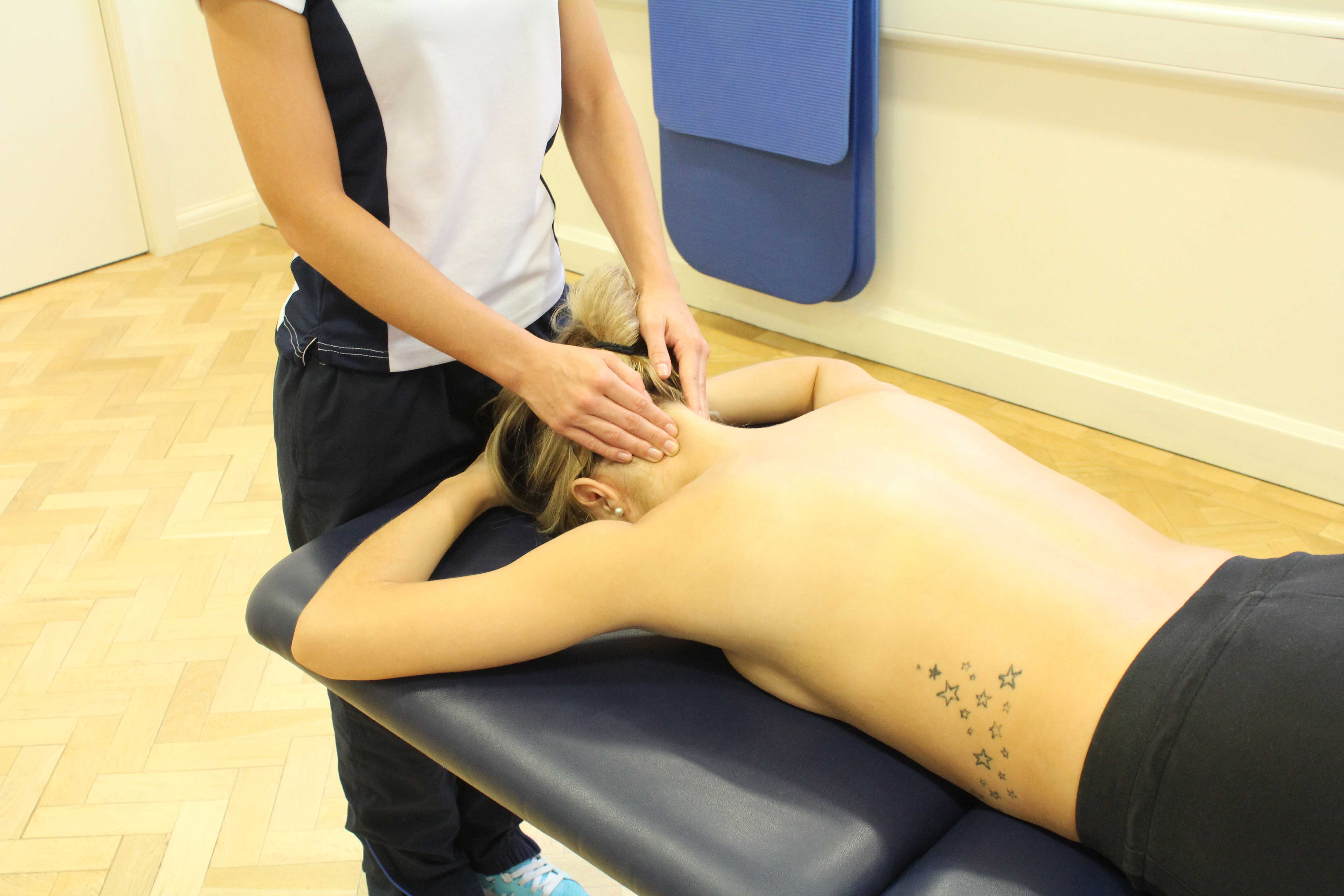 Soft tissue massage and mobilisations of the cervical vertebrea to relieve stiffness and nerve impingement