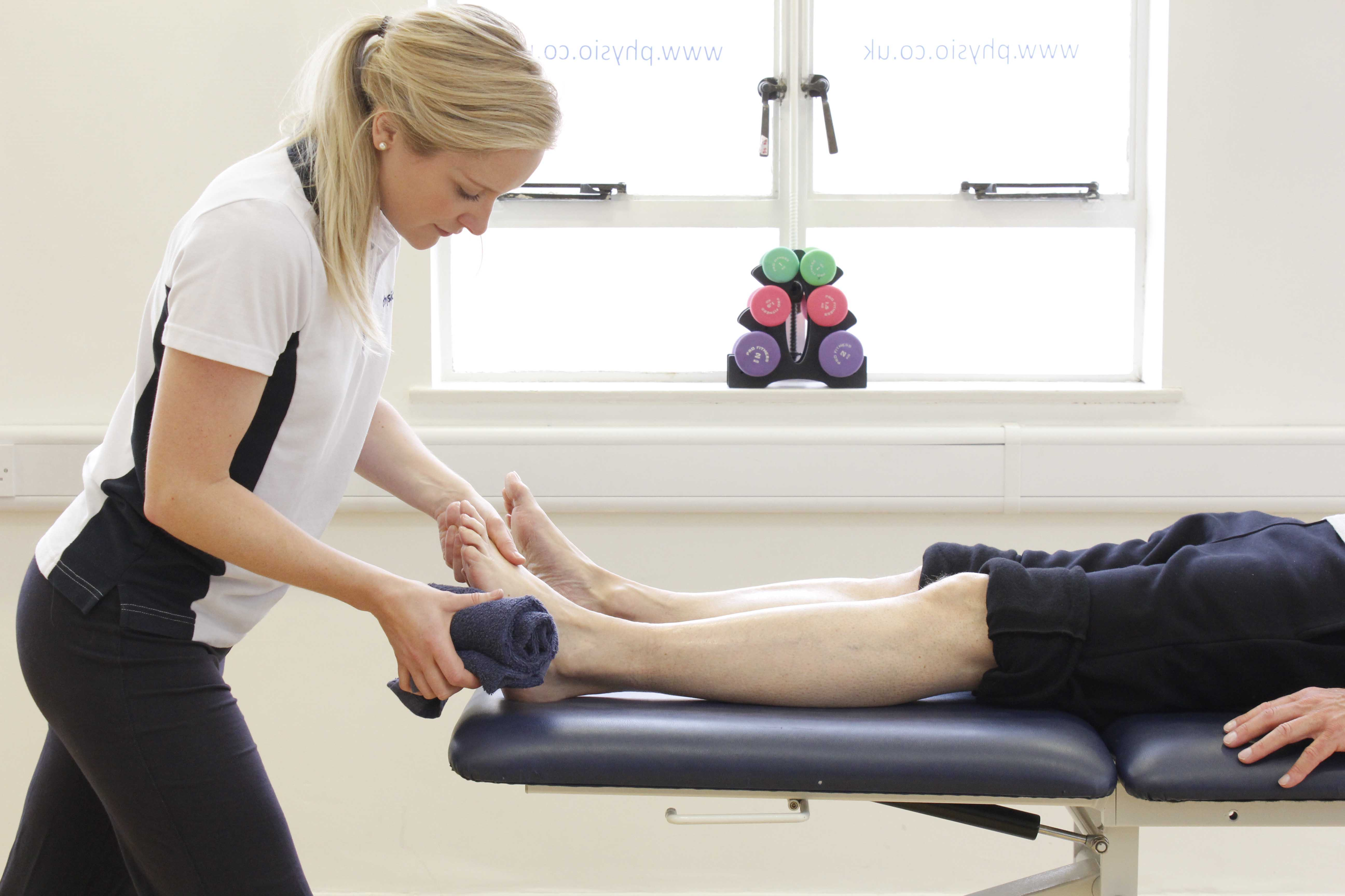 Neurological physiotherapist conducting sensation normilisation exercises