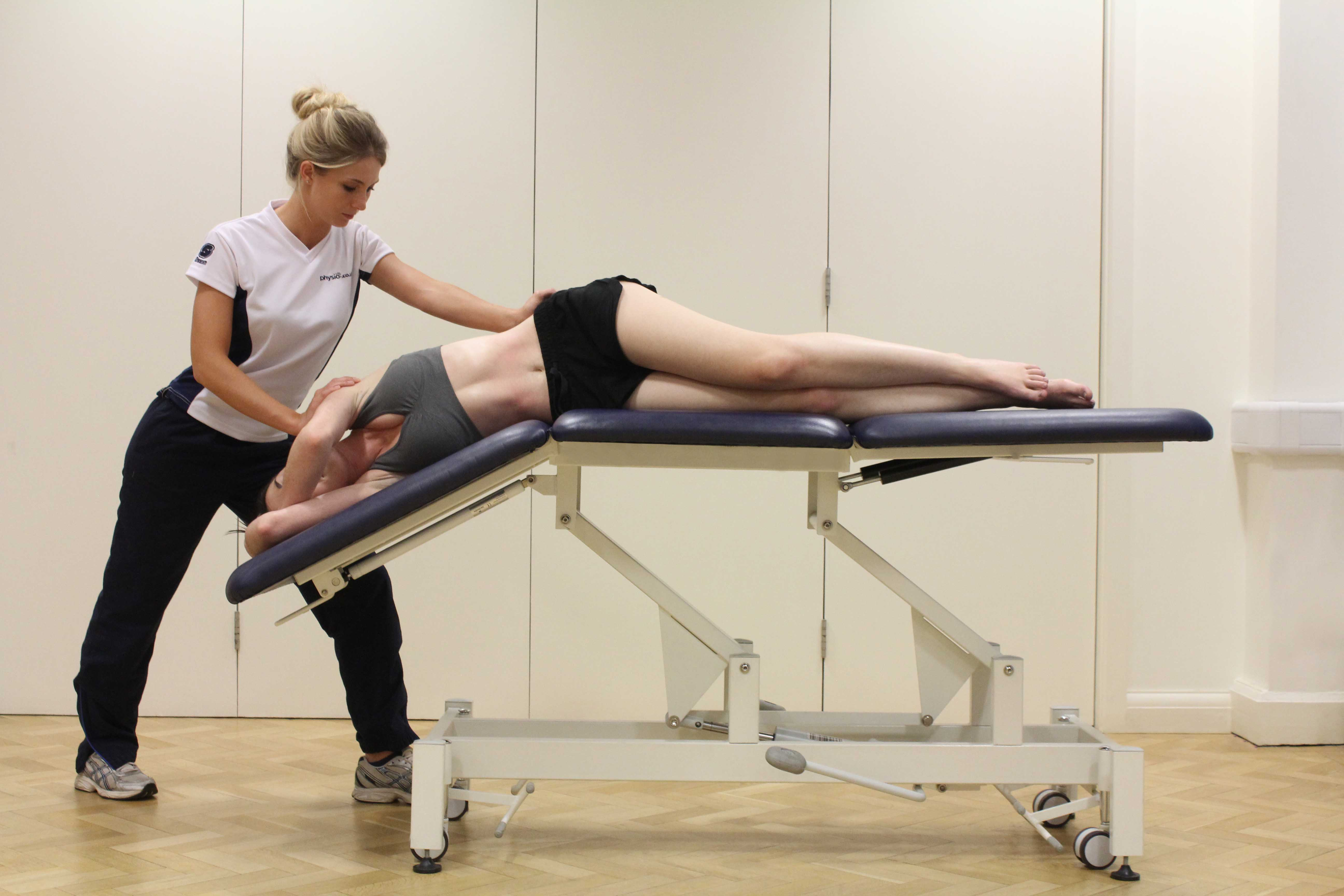 Postural drainage and chest clearence exercises assisted by a specilaist therapist