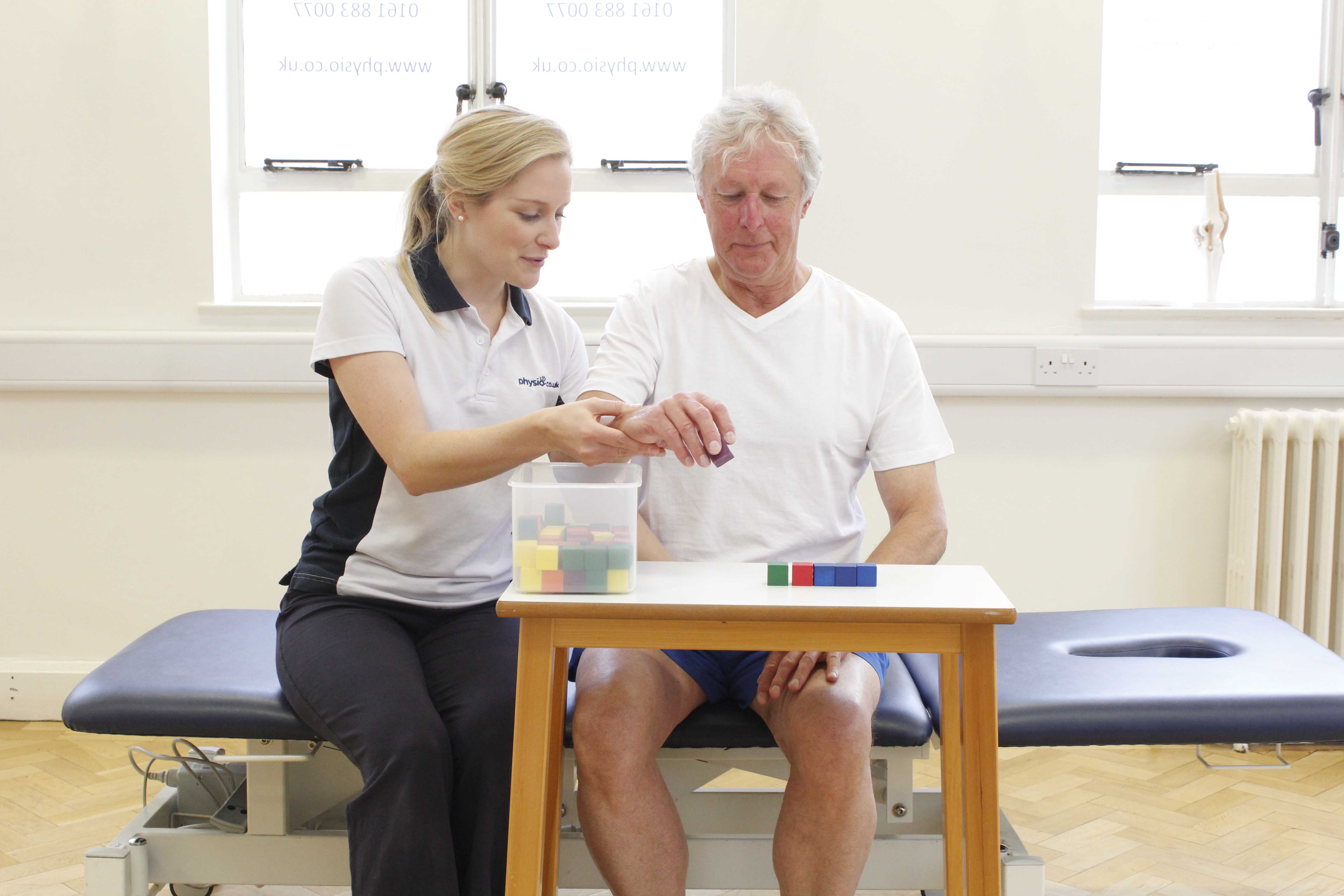 Fine motor skill exercises supervised by a specilaist neurological physiotherapist