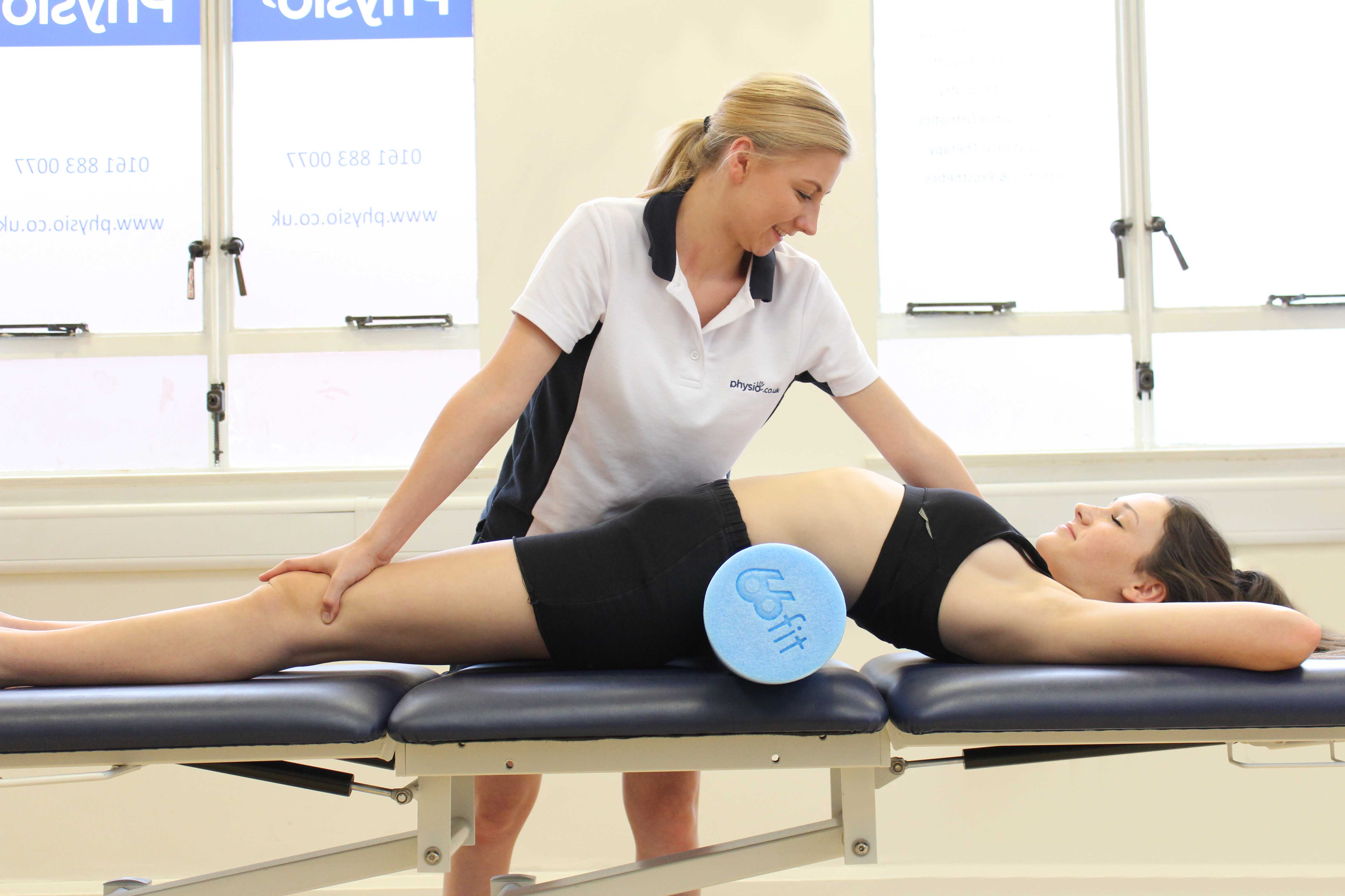 Deep tissue massage of the gluteus muscles by an experienced physiotherapist