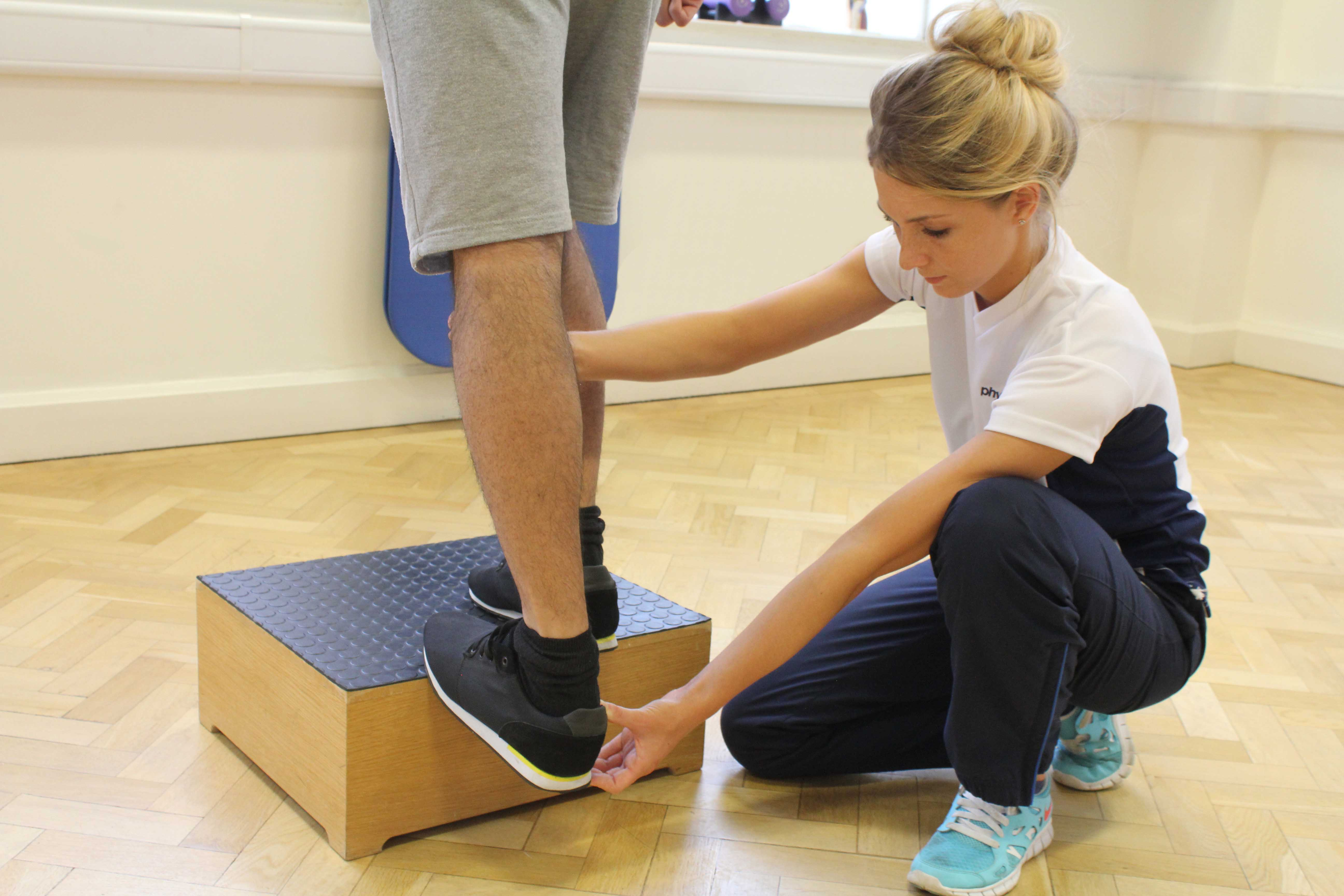 Progressive ankle strengthening exercises supervised by specialised therapist