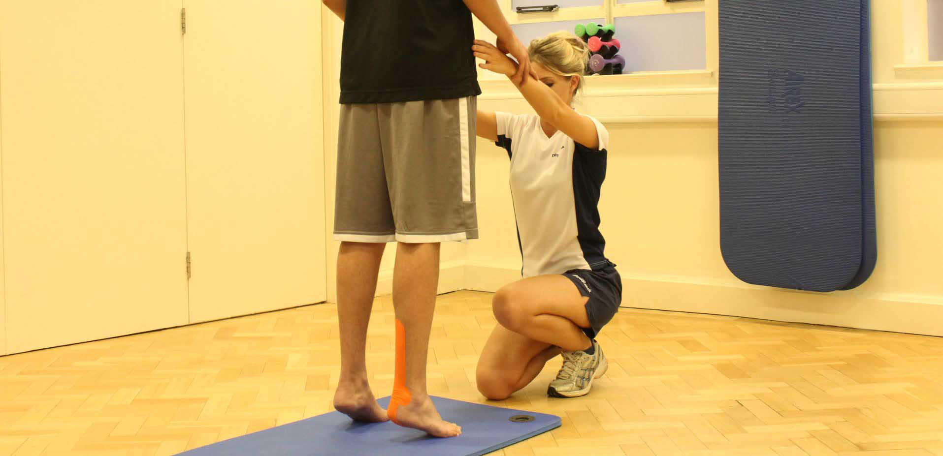Supportive tape applied to ankle by experienced therapist