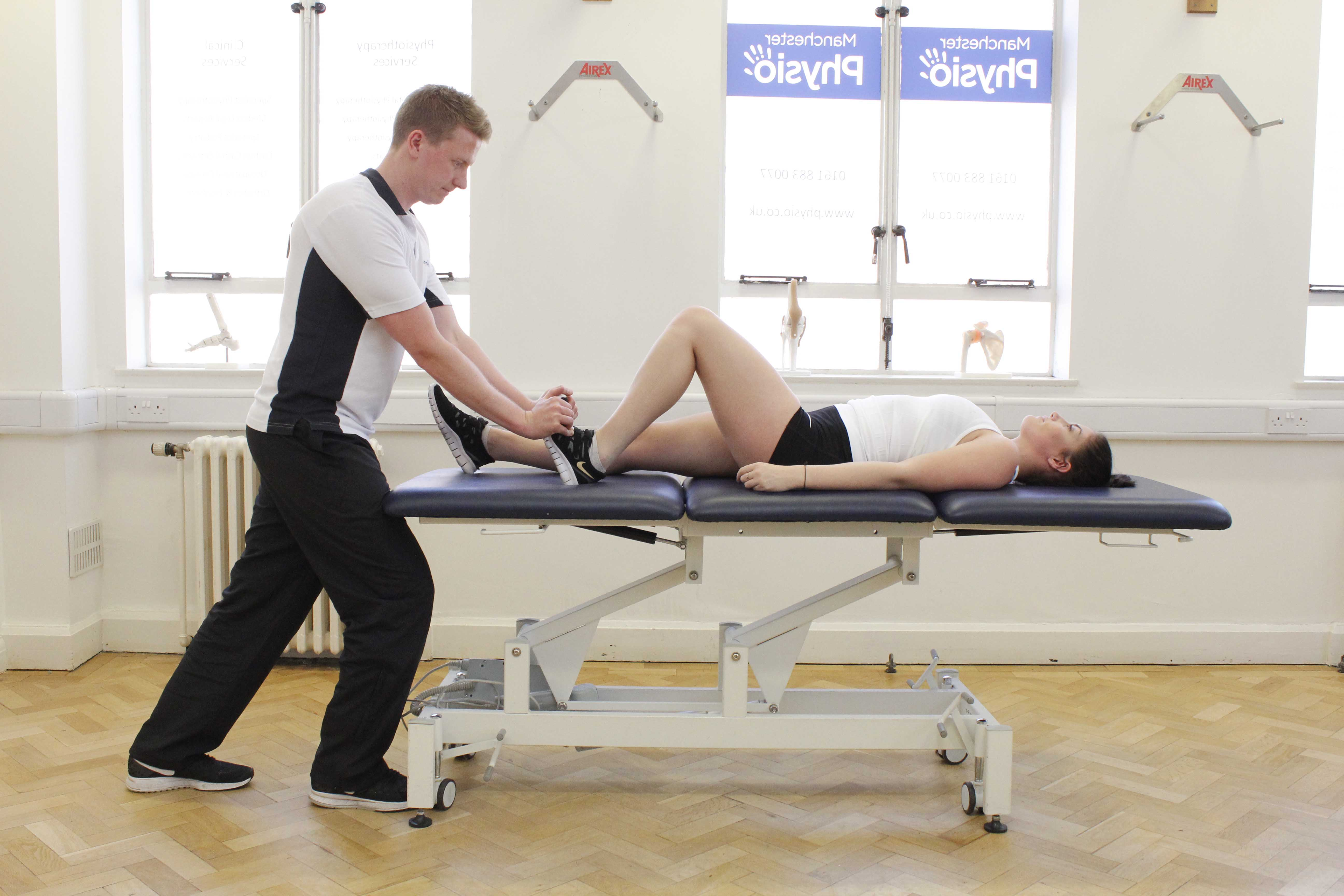 Passive stretch of the achilles tendon performed by specialist therapist