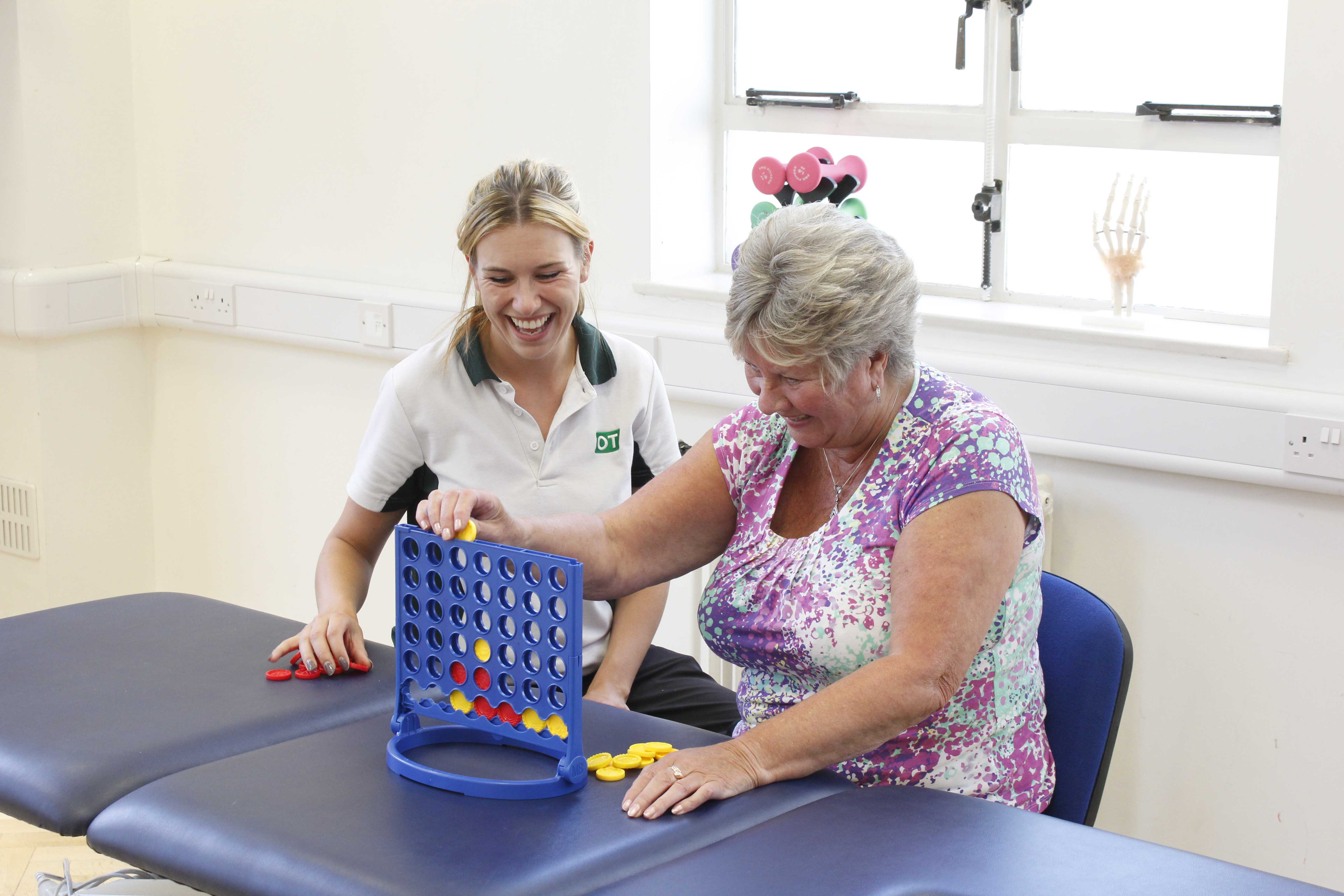 Occupational therapist supervising functional fine motor skill exercises