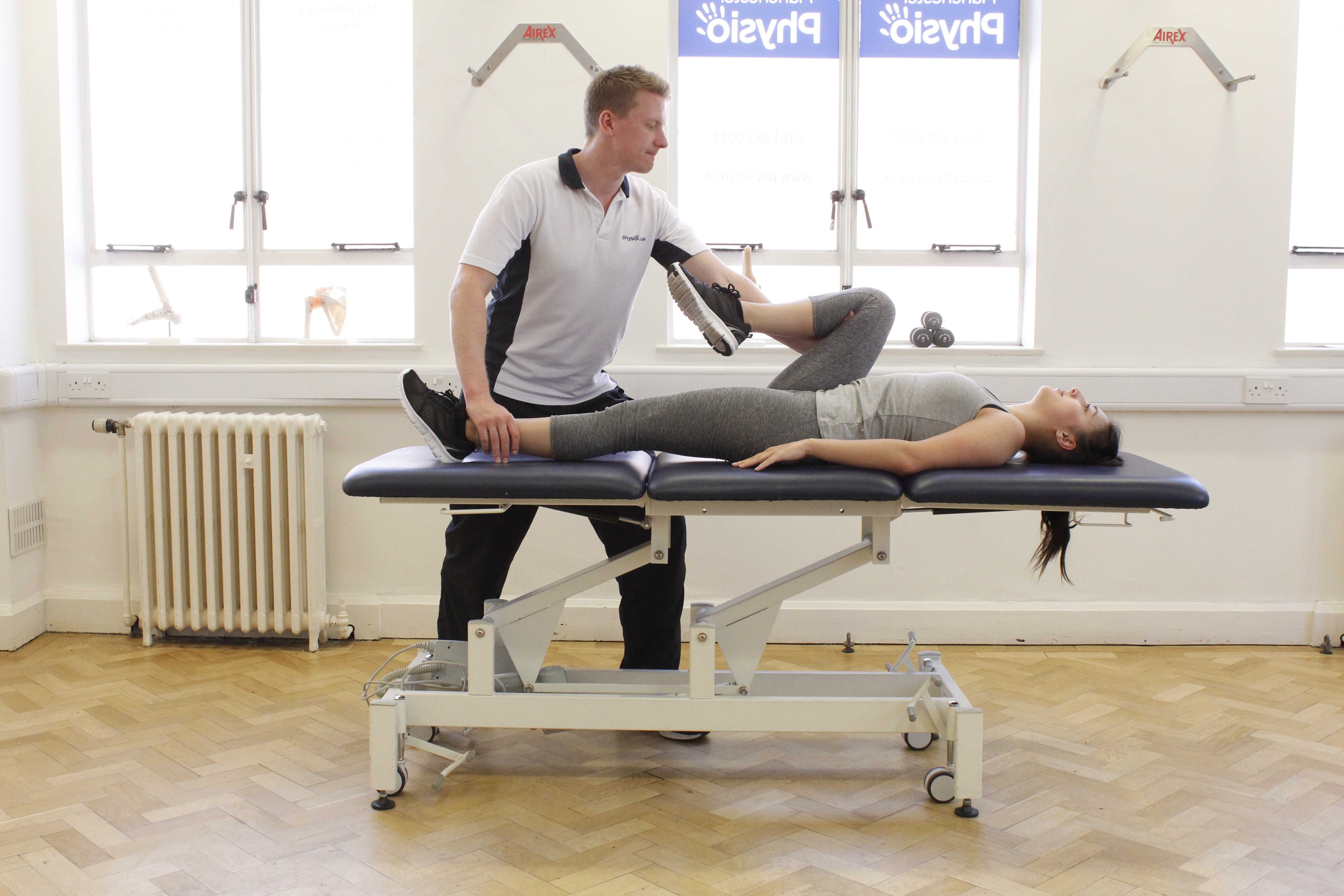 Stretches to the hip and knee conducted by a musculoskeletal physiotherapist