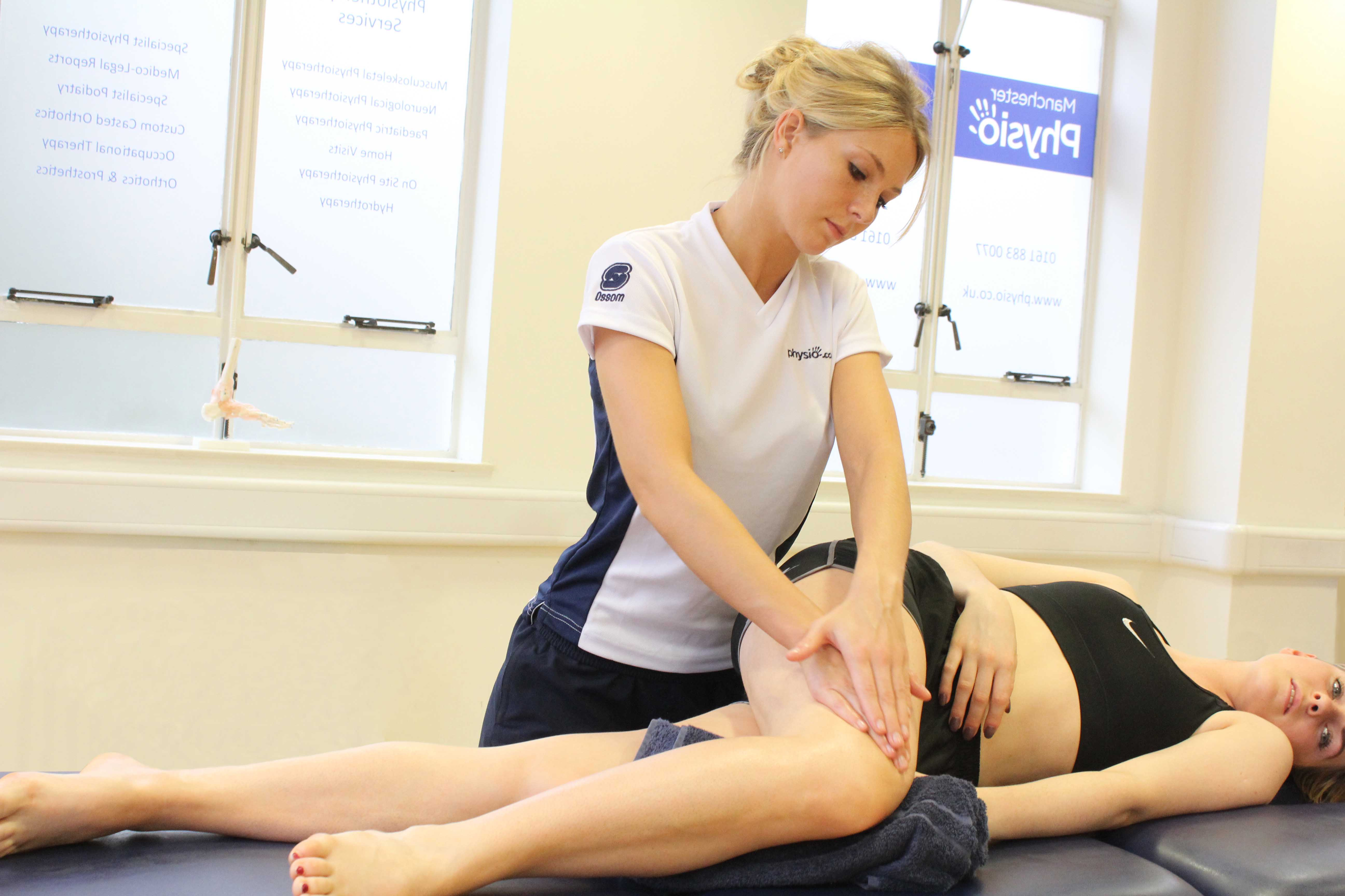 Soft tissue massage of the connective tissue around the patella and knee joint