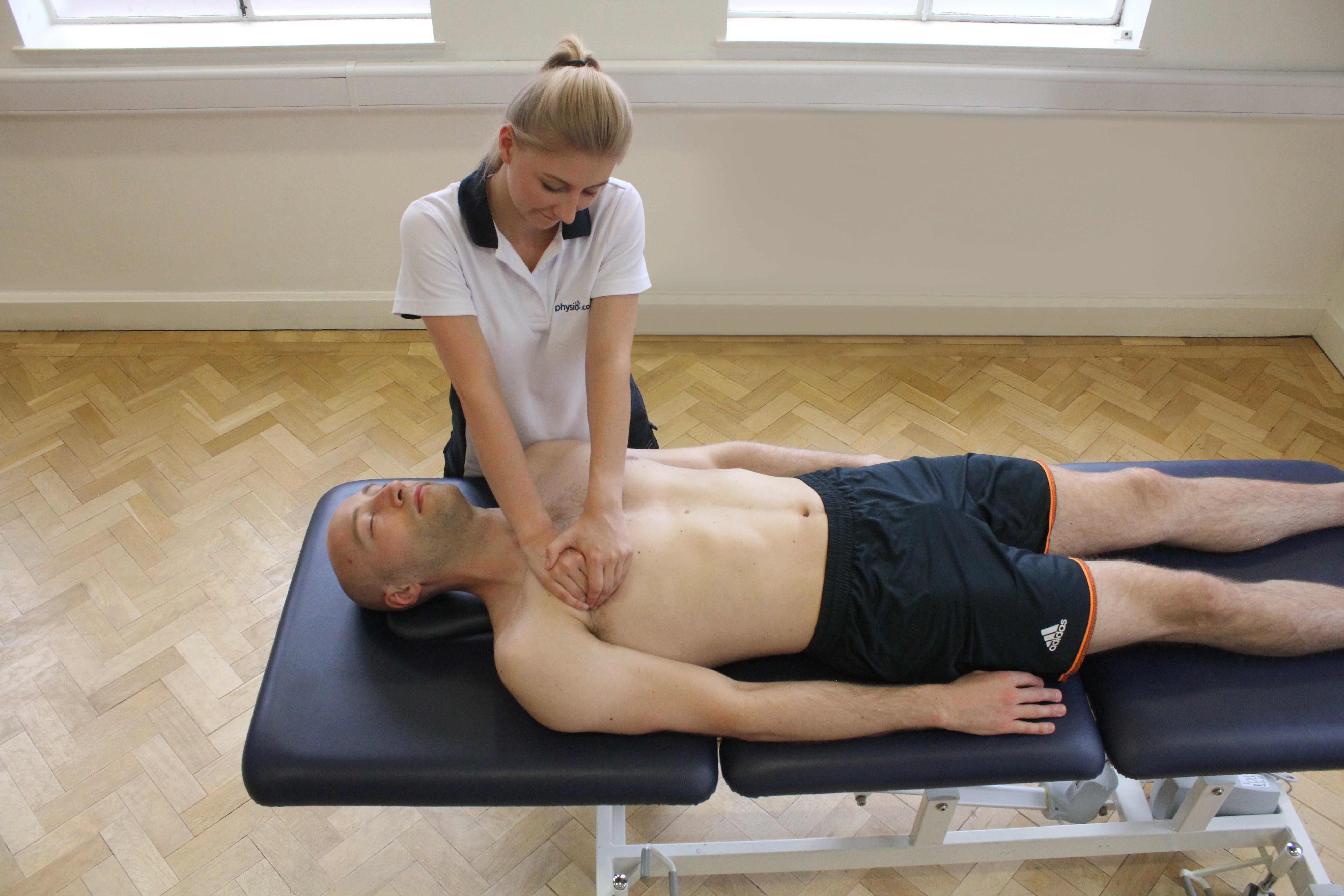 Soft tissue massage of the chest muscle and connective tissues