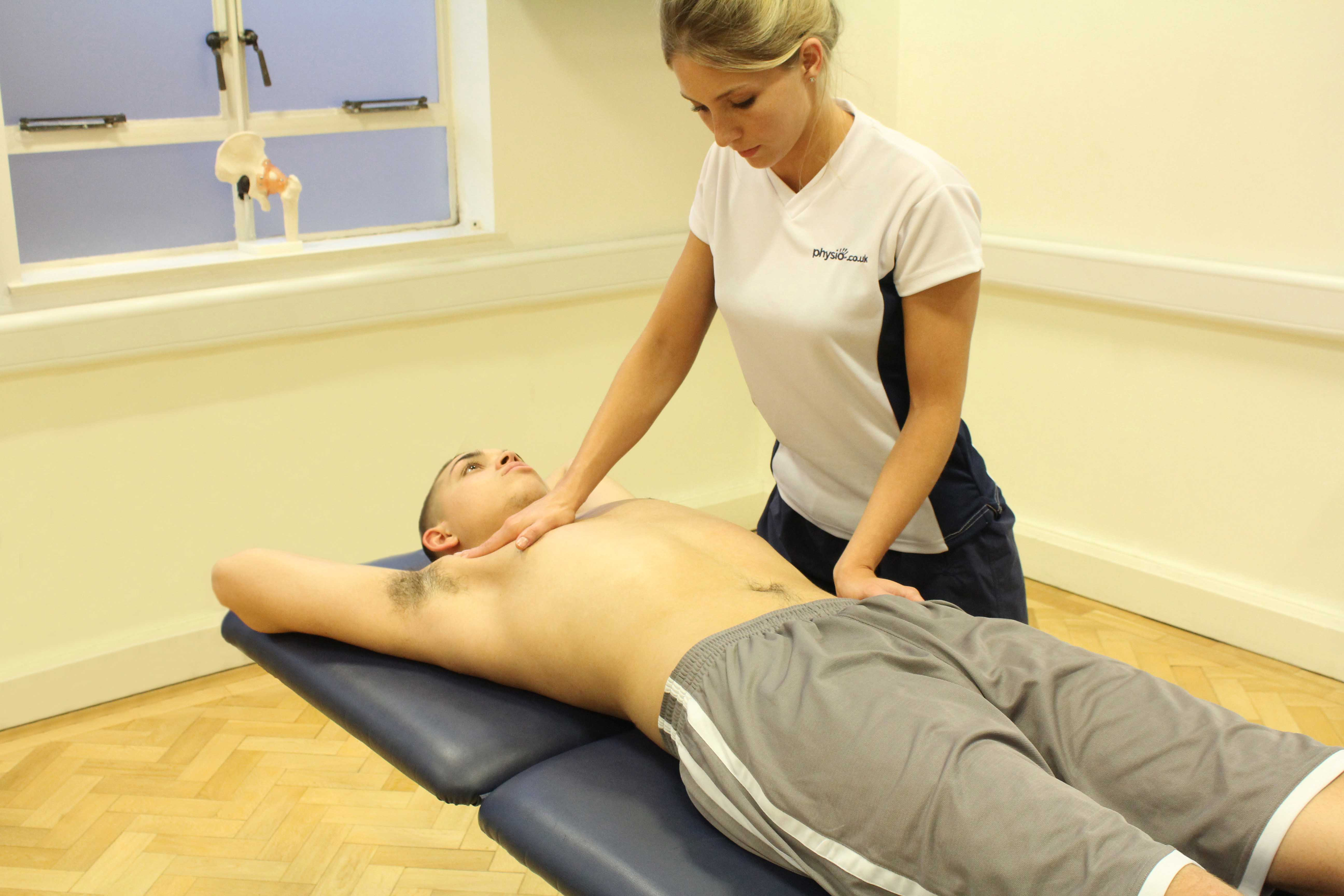 Passive stretch applied to chest muscels by experienced therapist