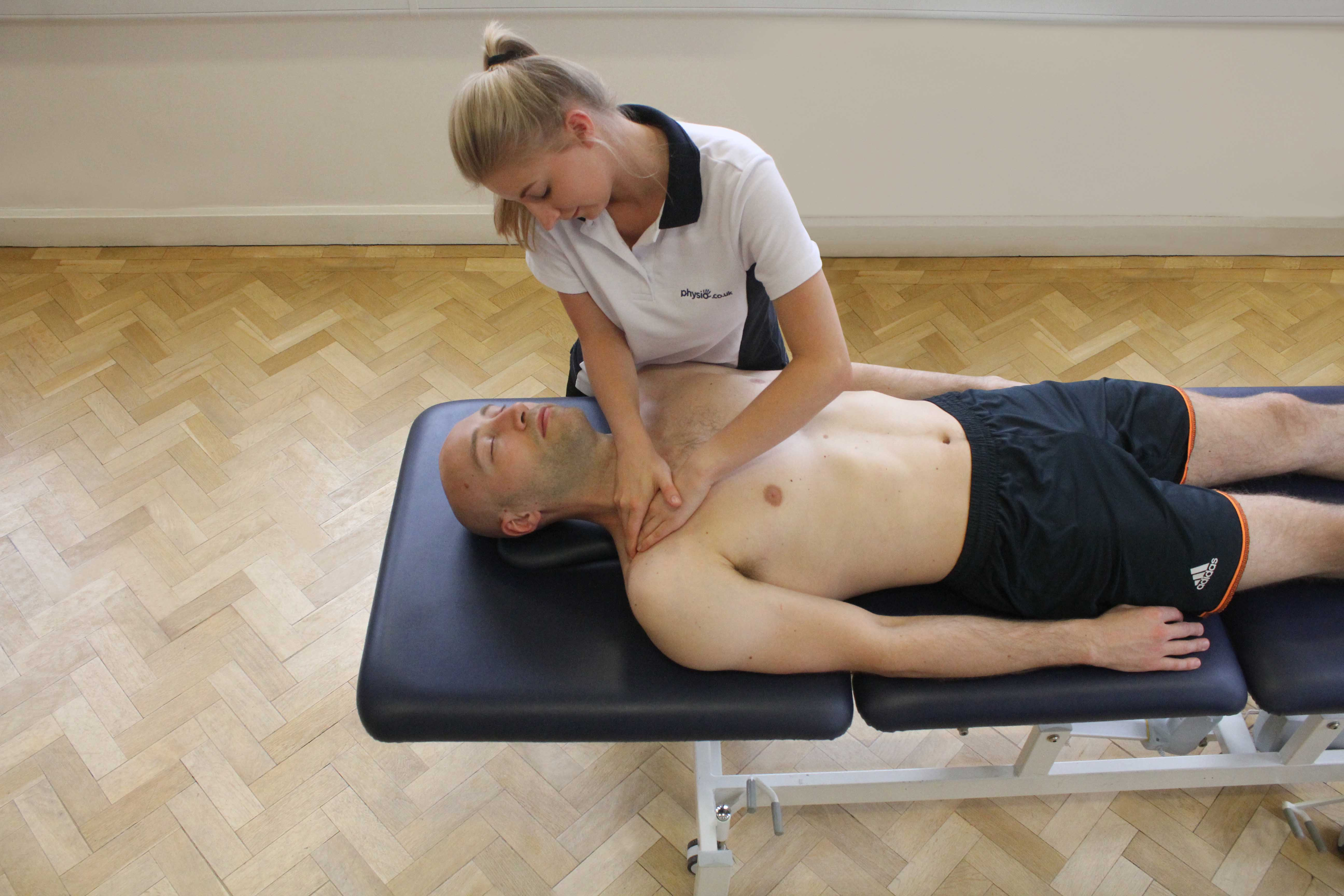 Soft tissue massage of the pectrol muscle by experienced therapist