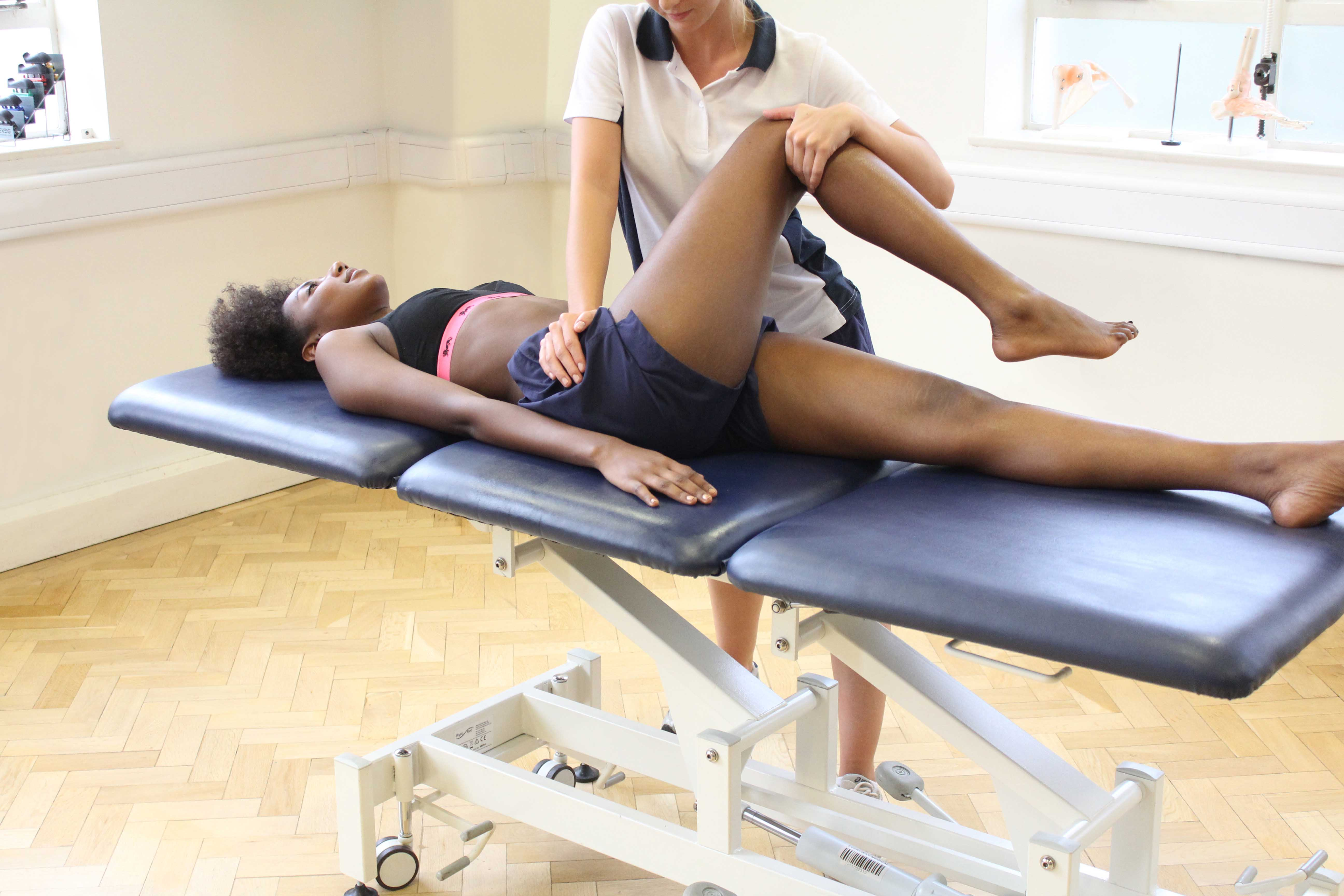 Passive stretch of the hip and pelvic muscles and connective tissues by specialist MSK therapist