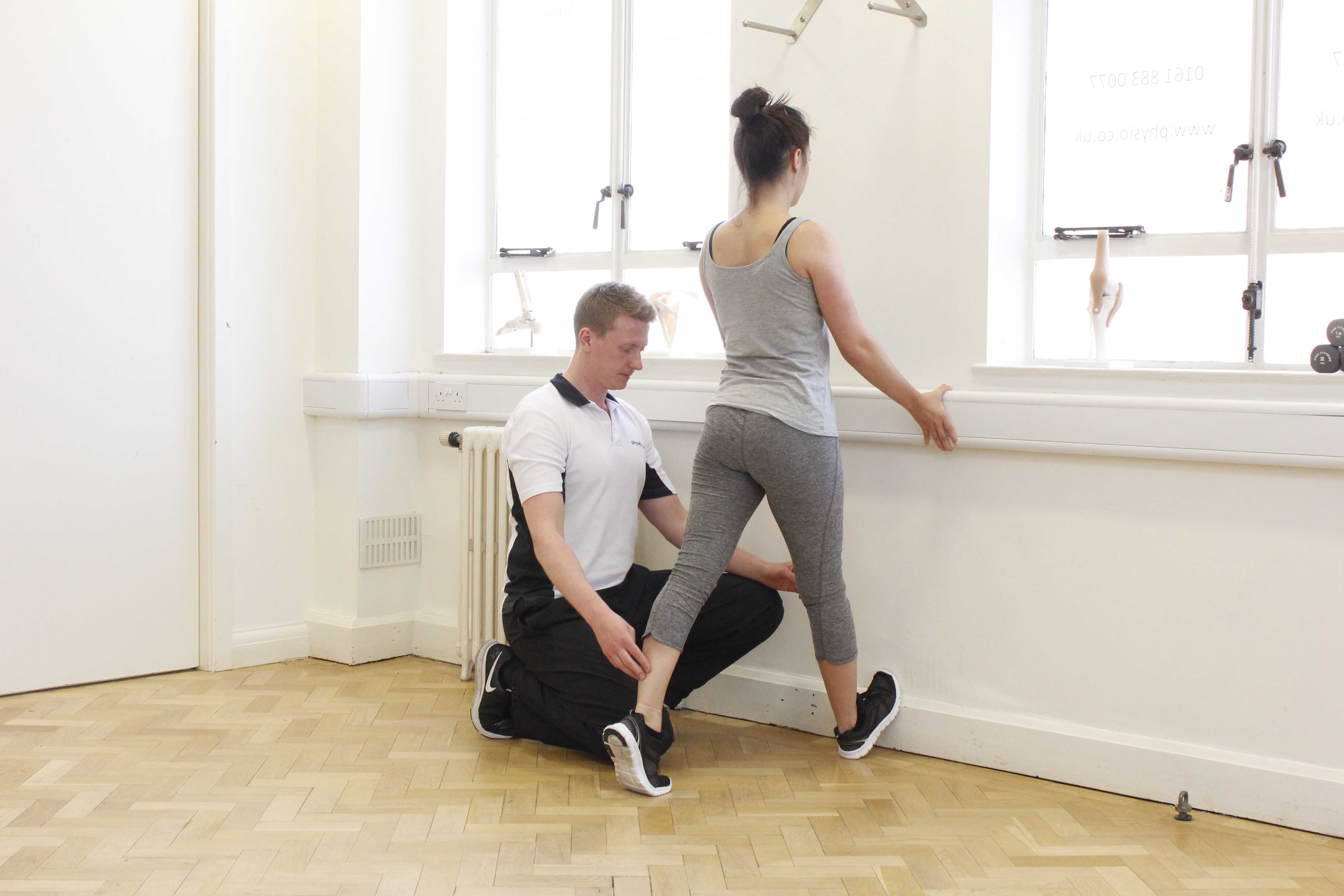 Ankle and calf stretches supervised by an experienced physiotherapist