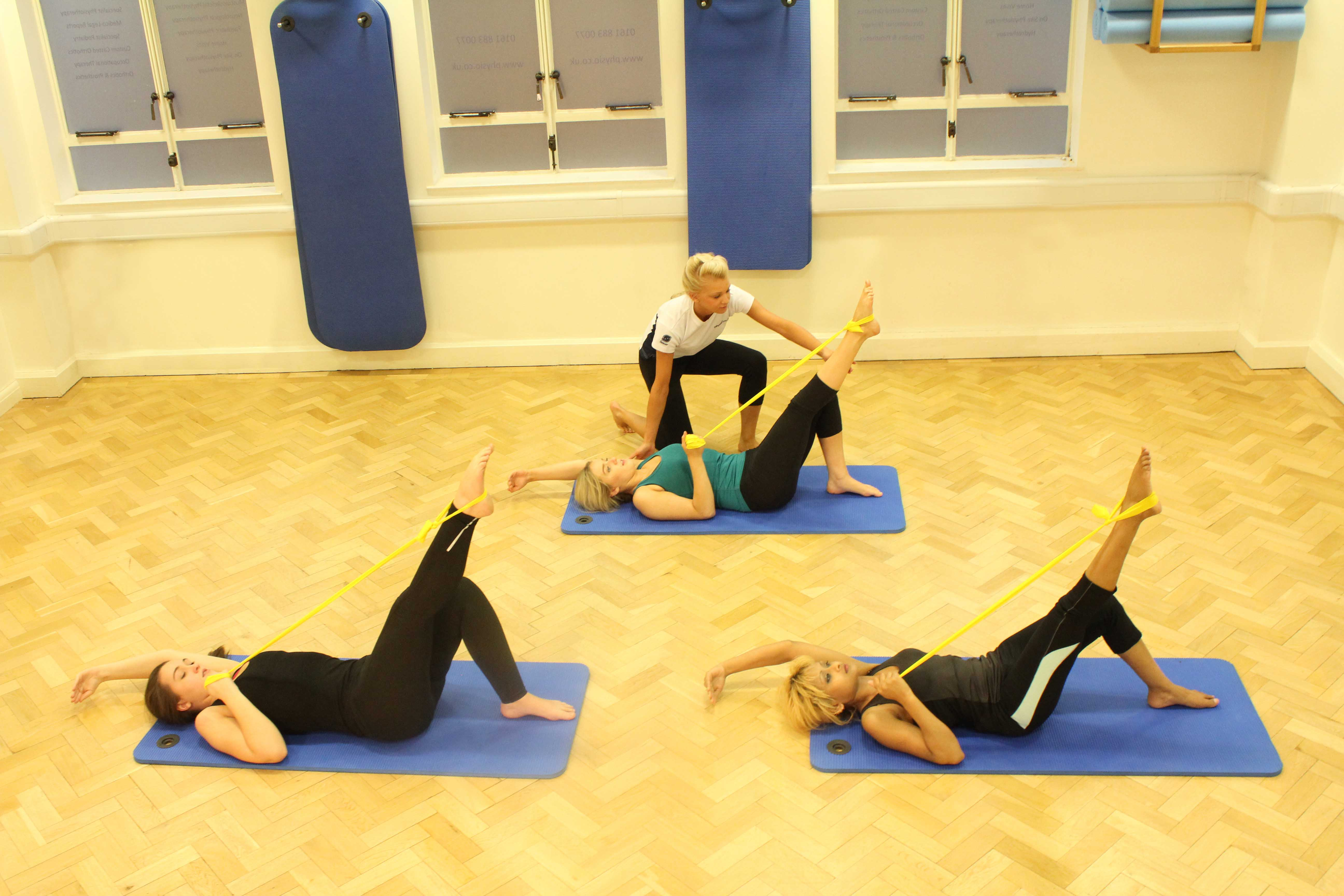Physiotherapist led pilates class using resistance bands